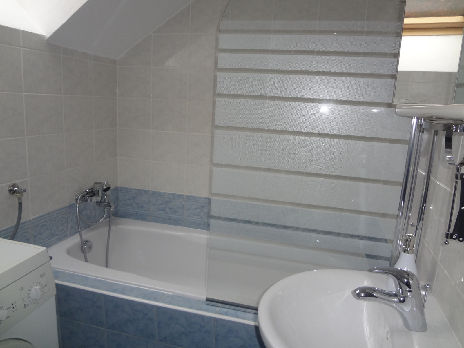 The bathroom in Fine Stay apartment comes complete with a bathtub and a washbasin