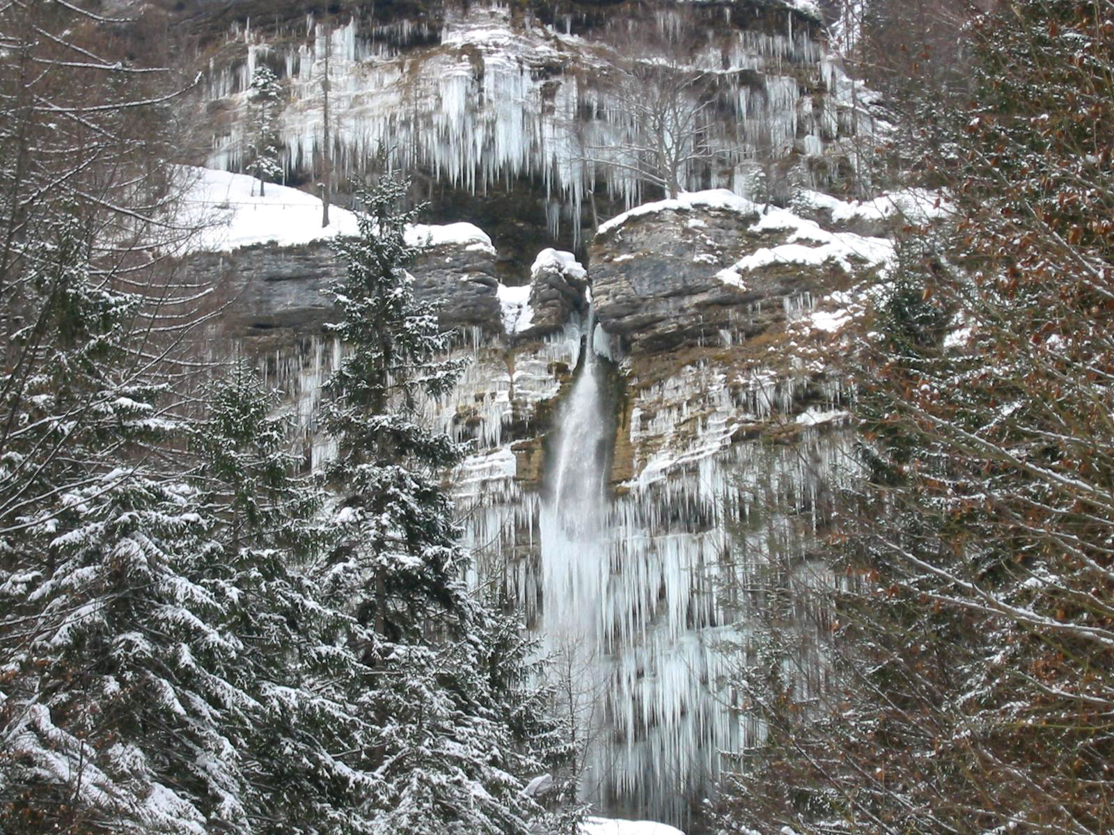 Pericnik waterfall from the distance in winter