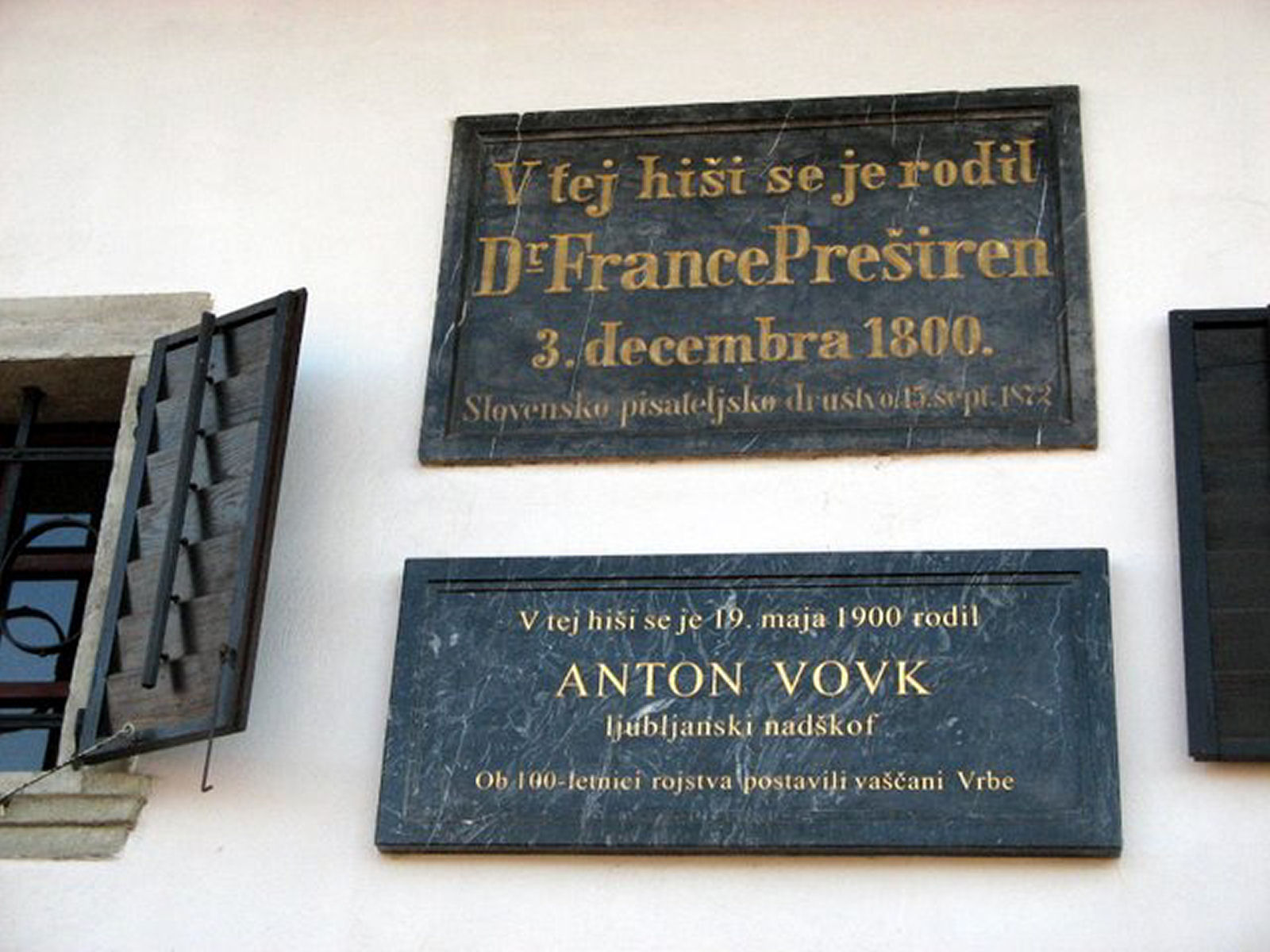 Two memorial plaques are built in the entrance façade, commemorating the birth of France Preseren and Archbishop Anton Vovk.