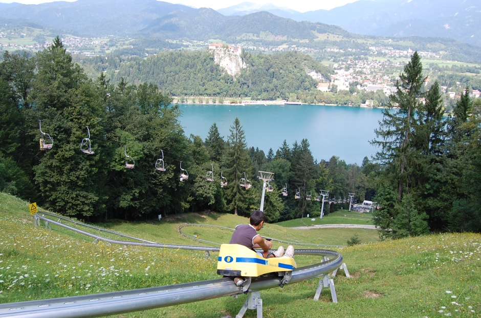 Summer sledding on the Straza ski slope above Lake Bled