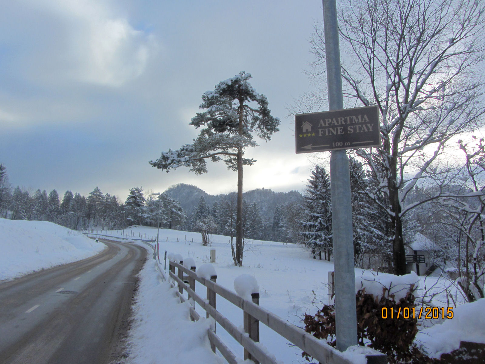 Fine Stay apartment road sign in winter