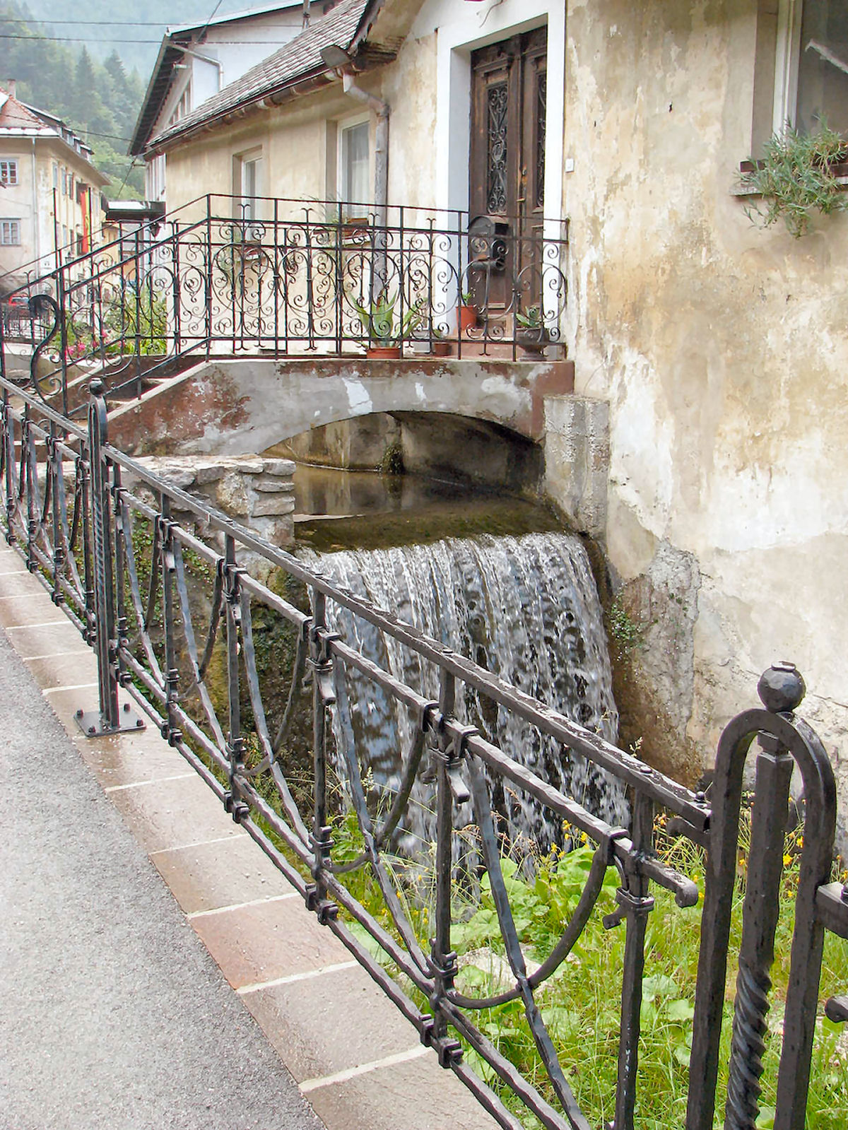 Hand forged grey decorative iron fence in the village of Kropa, Slovenia