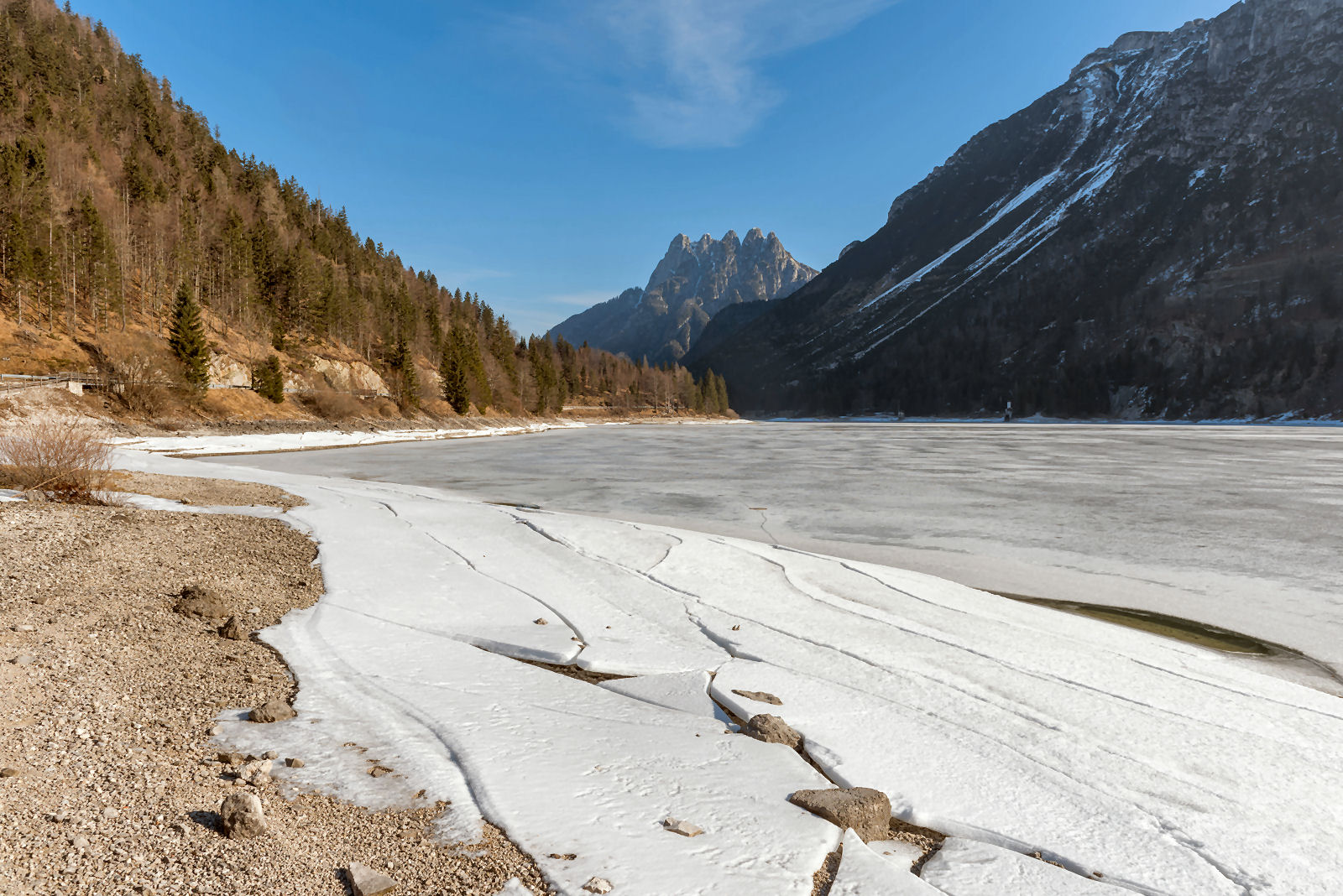 The frozen Lake Predil in winter with the Cinque Punte mountain in the background