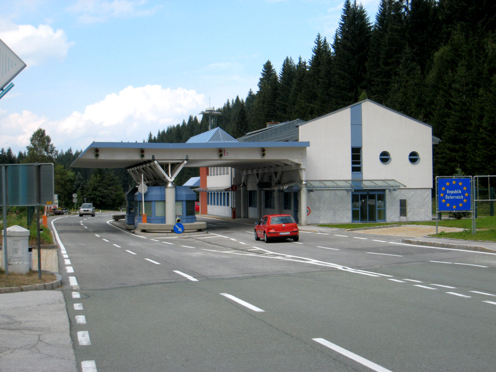 The Austrian sign and border post at the Wurzen Pass