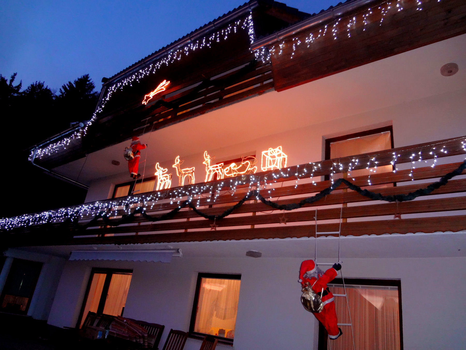 The best apartment in the Lake Bled area lit up in Christmas lights