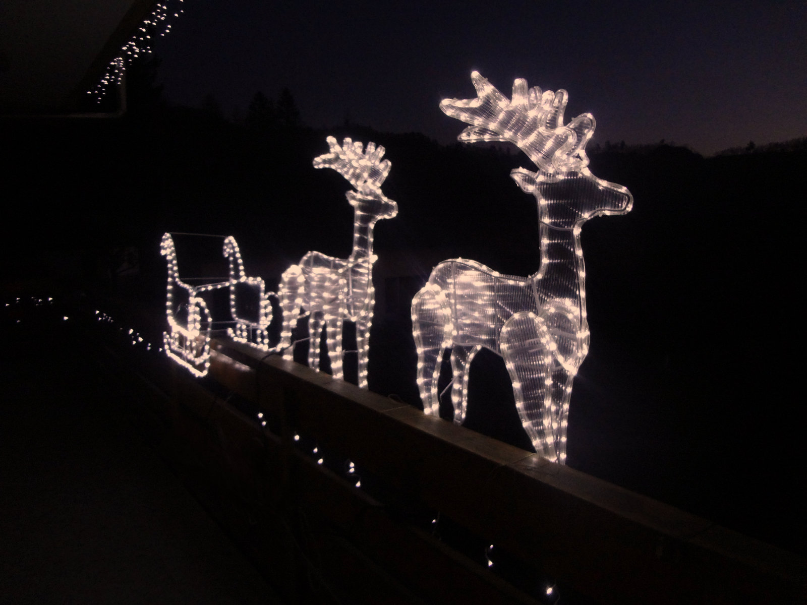Exterior of the Fine Stay Apartment during the festive season with Christmas lights and reindeers