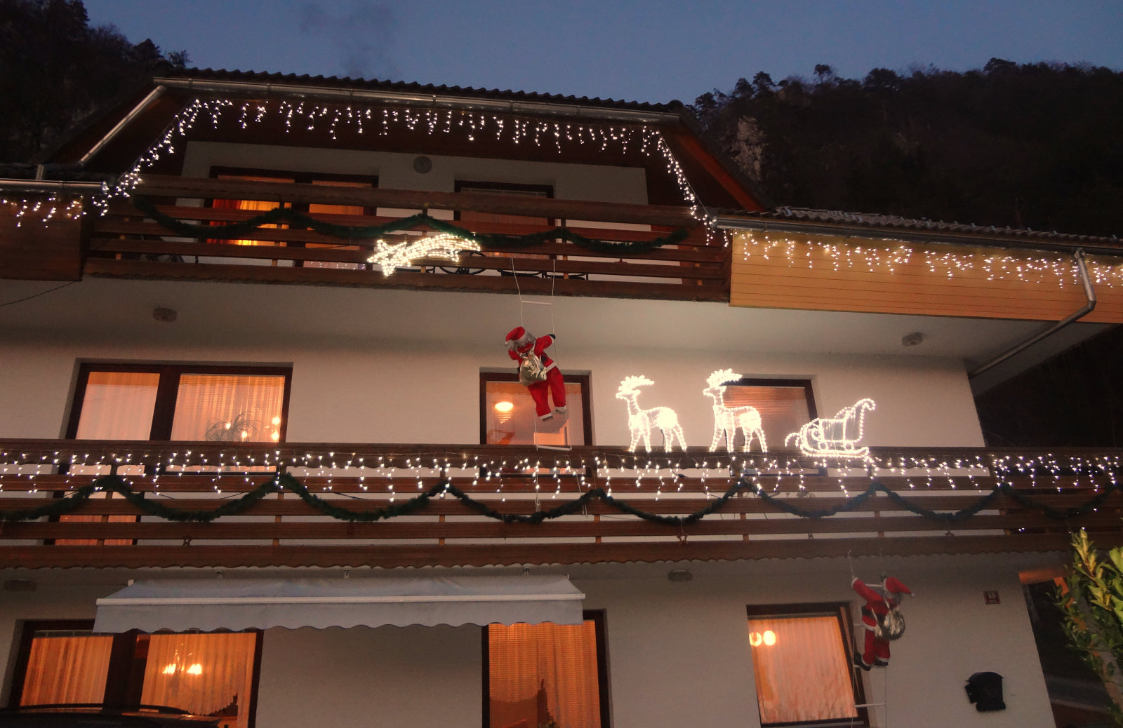 Exterior of the Fine Stay Apartment during the festive season decorated with Christmas lights
