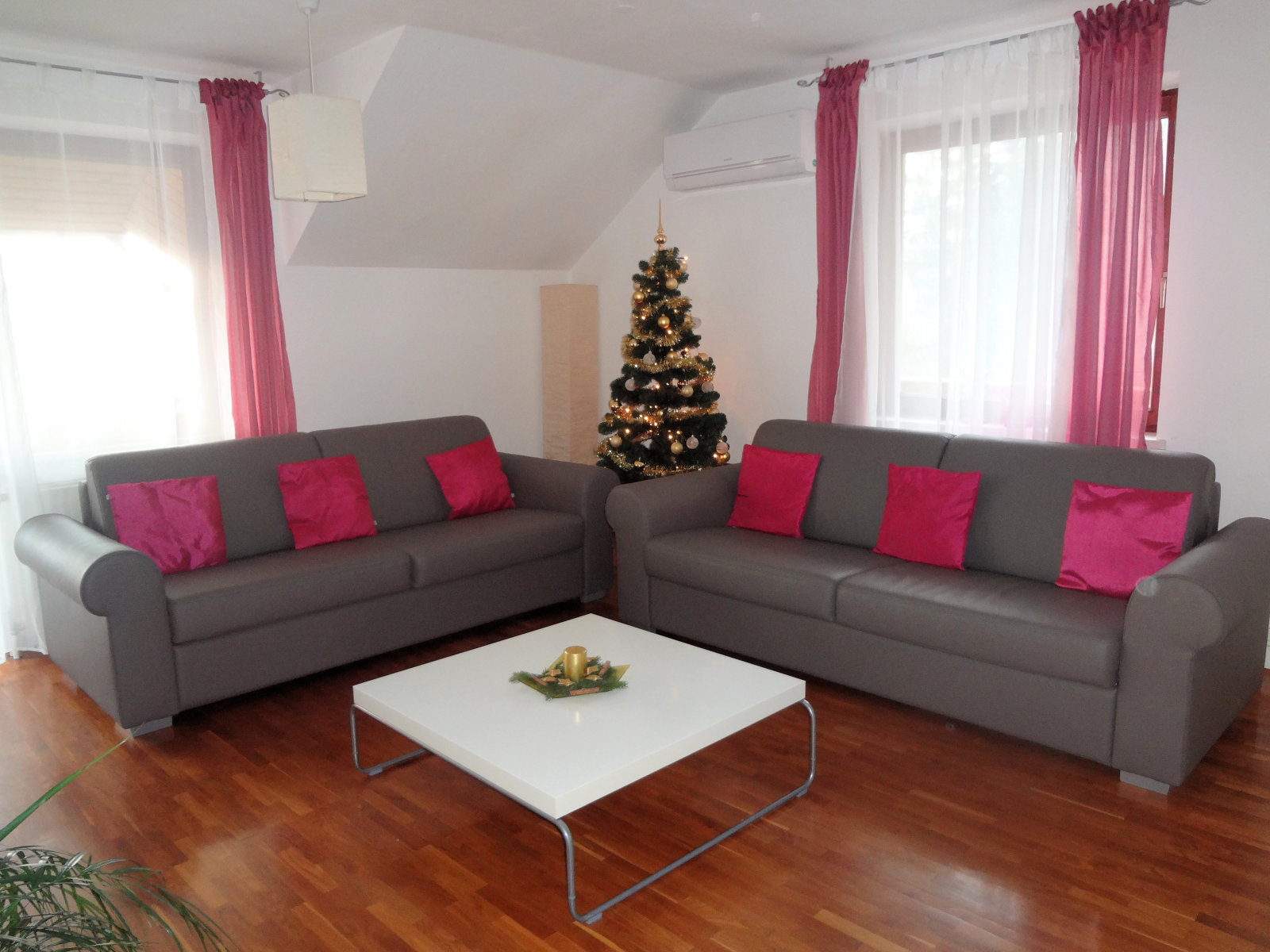 A Christmas tree with lights in the Fine Stay Apartment in Slovenia
