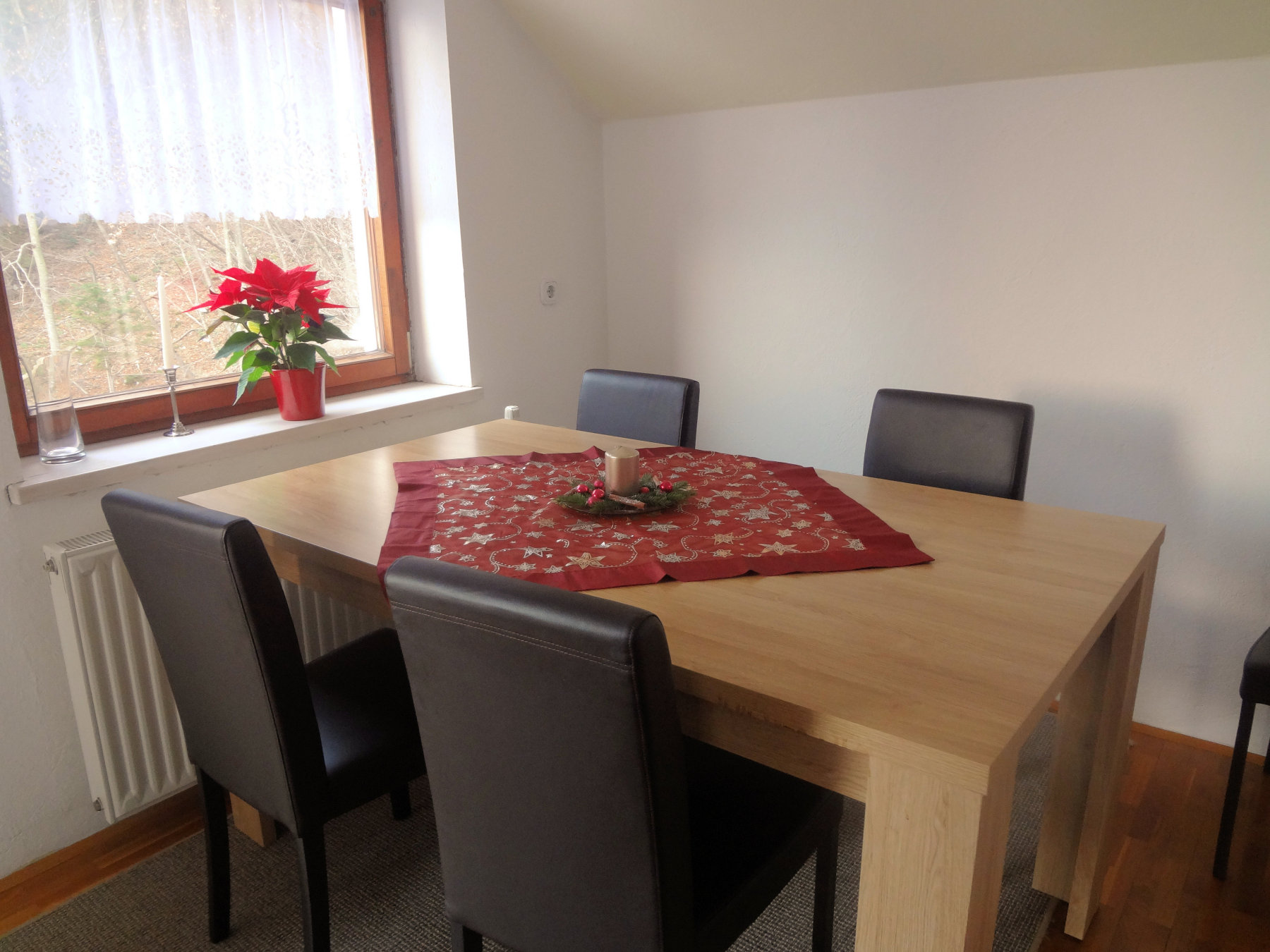 Fine Stay Apartment in Slovenia with some holiday decorations and a poinsettia
