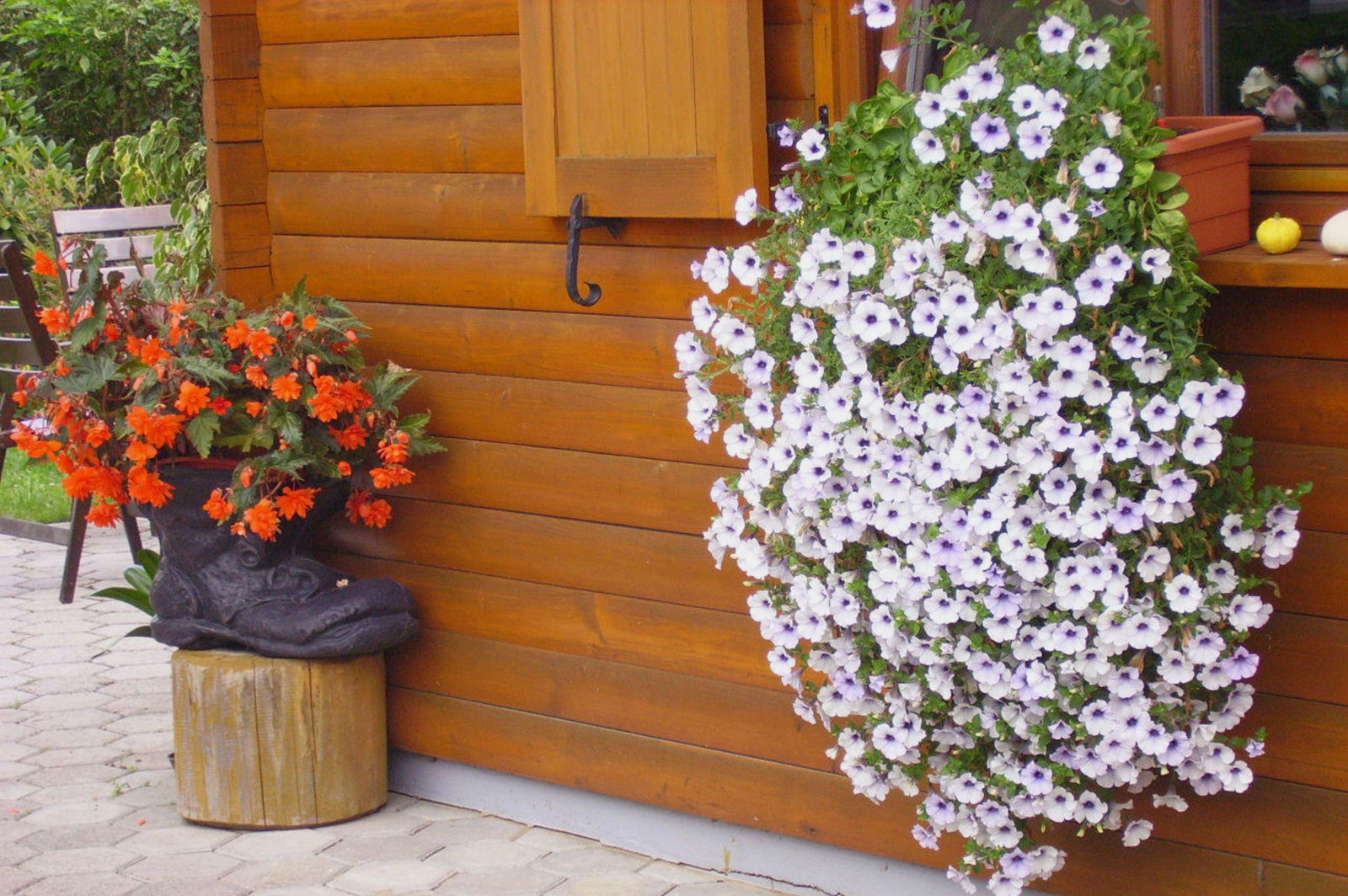 A wooden hut with flowers outside the Fine Stay Bled apartment in Lake Bled, Slovenia