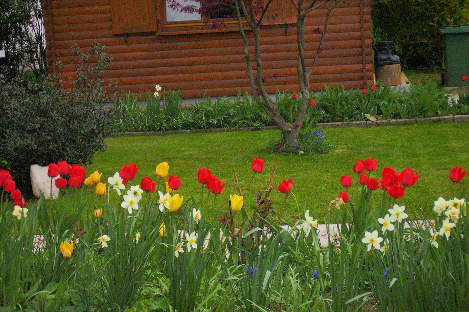 A garden in front of the Fine Stay Bled apartment in Lake Bled, Slovenia