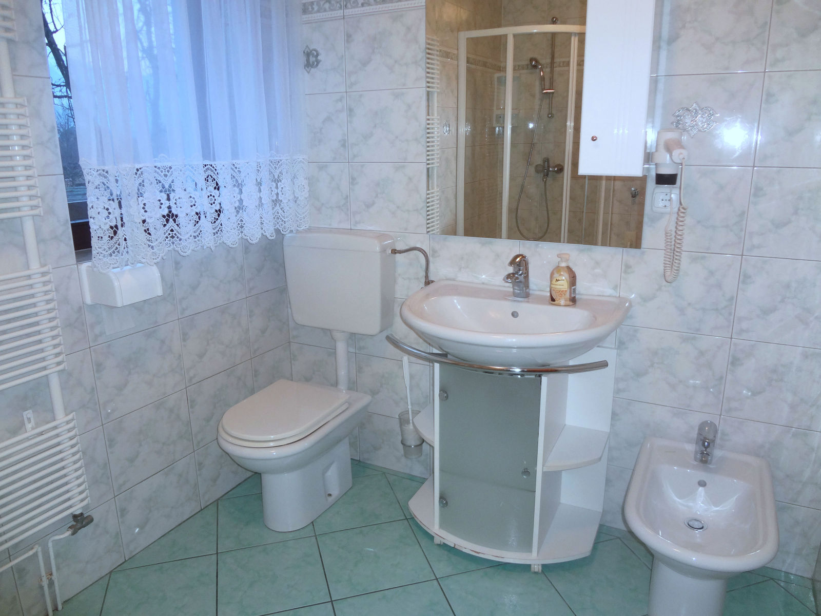 Bathroom with a toilet and bidet in the Fine Stay Bled apartment in Lake Bled, Slovenia