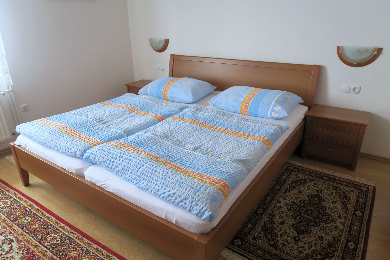 A comfortable double bed in the second bedroom of the Fine Stay Bled apartment in Lake Bled, Slovenia