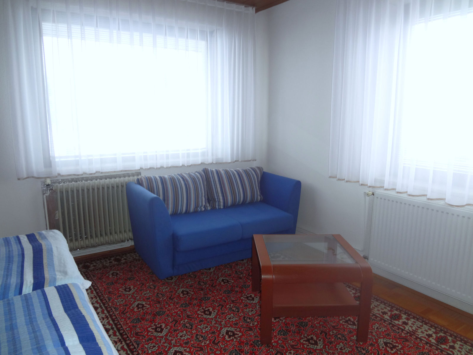 Two-seater sofa in the first bedroom of the Fine Stay apartment in Lake Bled, Slovenia