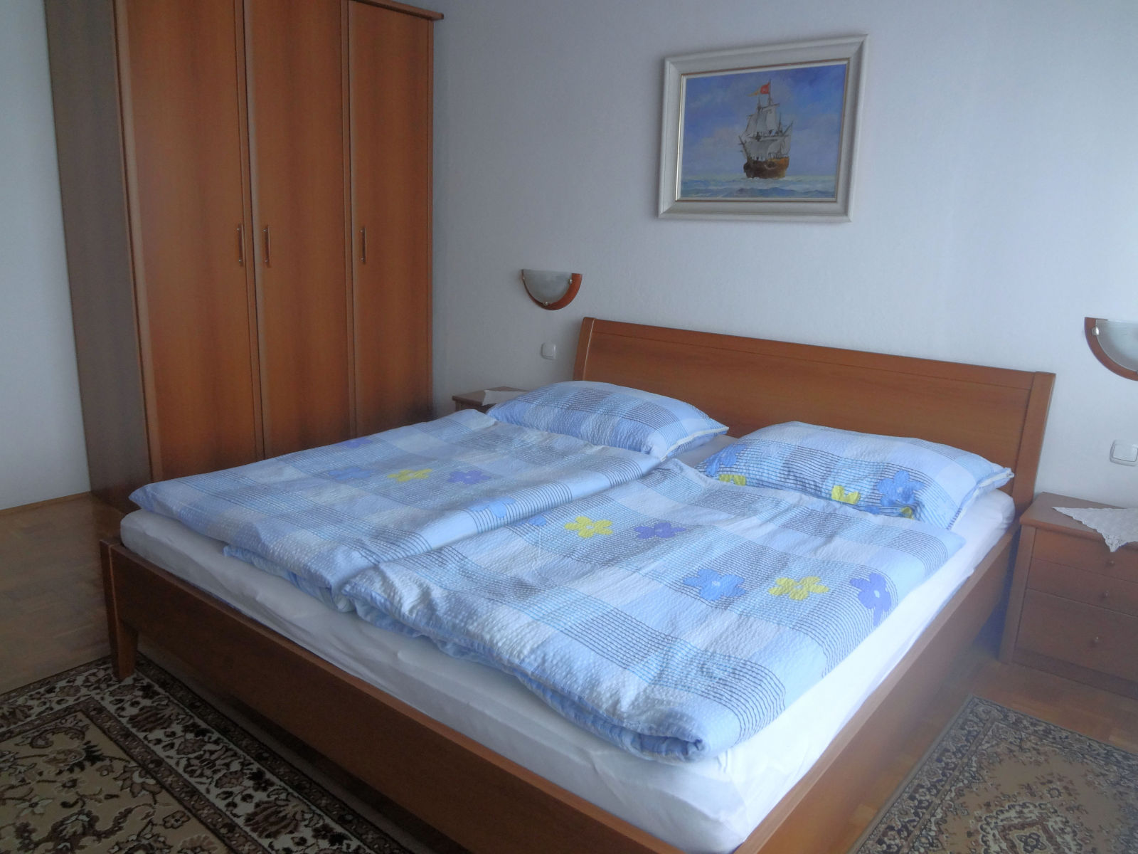 A king size bed and a closet in the second bedroom of the Fine Stay apartment in Lake Bled, Slovenia