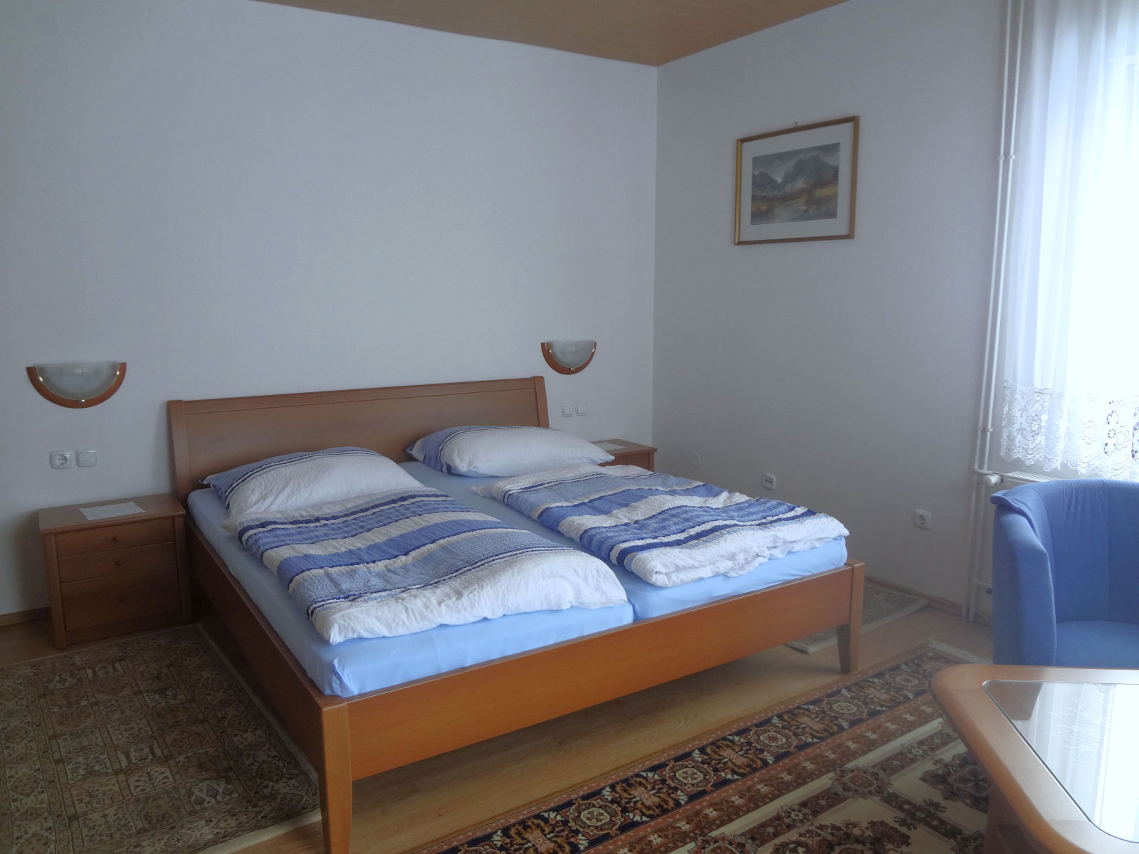 A large double bed in the first bedroom of the Fine Stay Bled apartment in Lake Bled, Slovenia