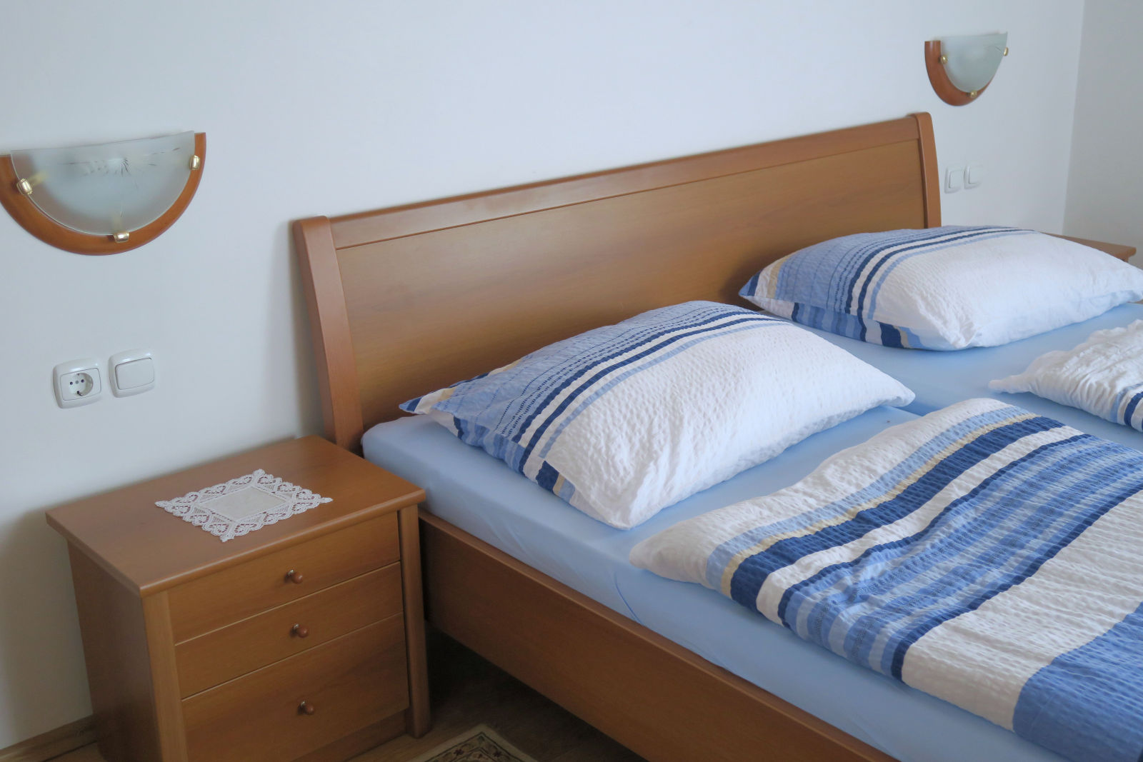 The comfortable bed in the first bedroom of the Fine Stay Bled apartment in Lake Bled, Slovenia