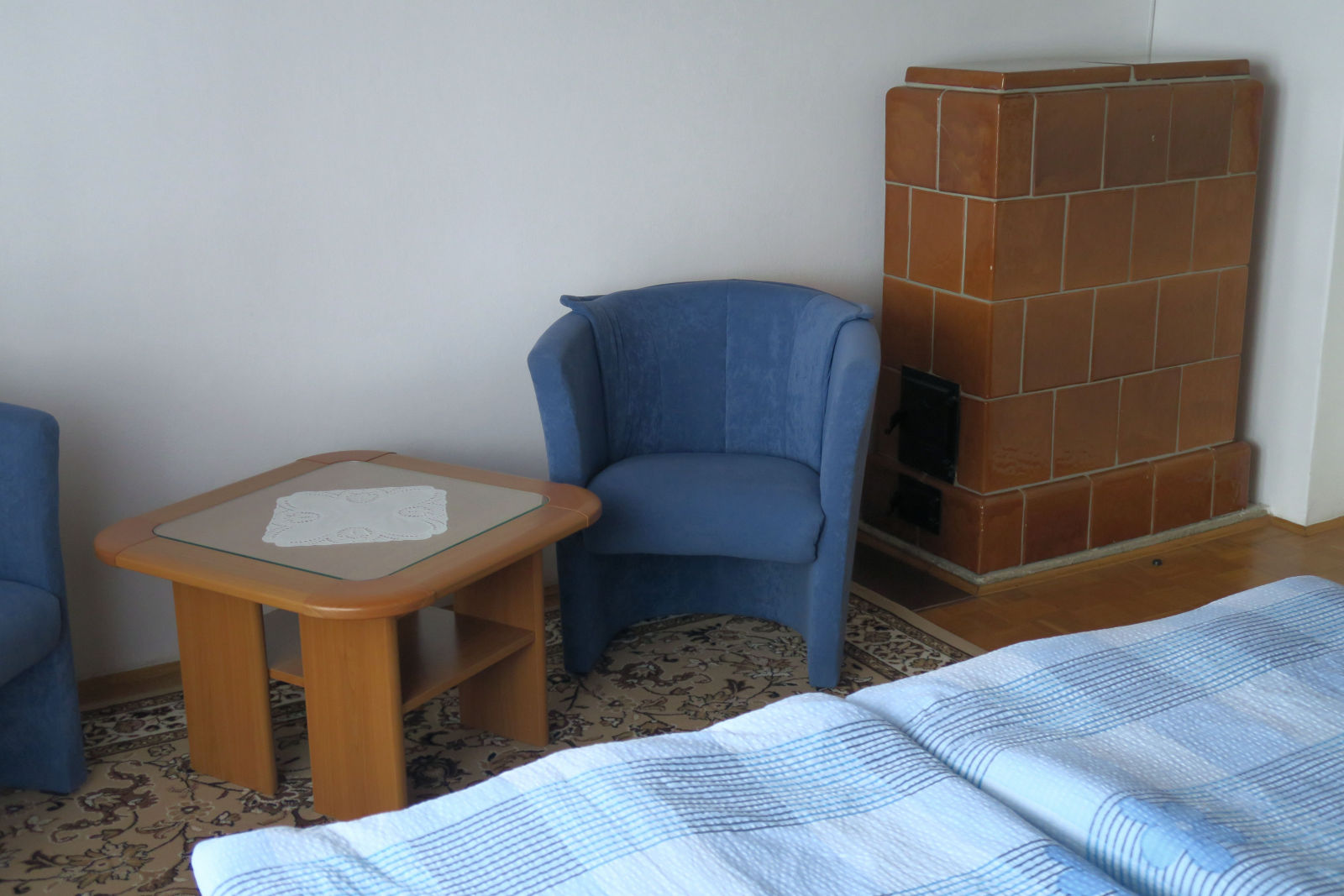 Two armchairs and a fireplace in the second bedroom of the Fine Stay apartment in Lake Bled, Slovenia
