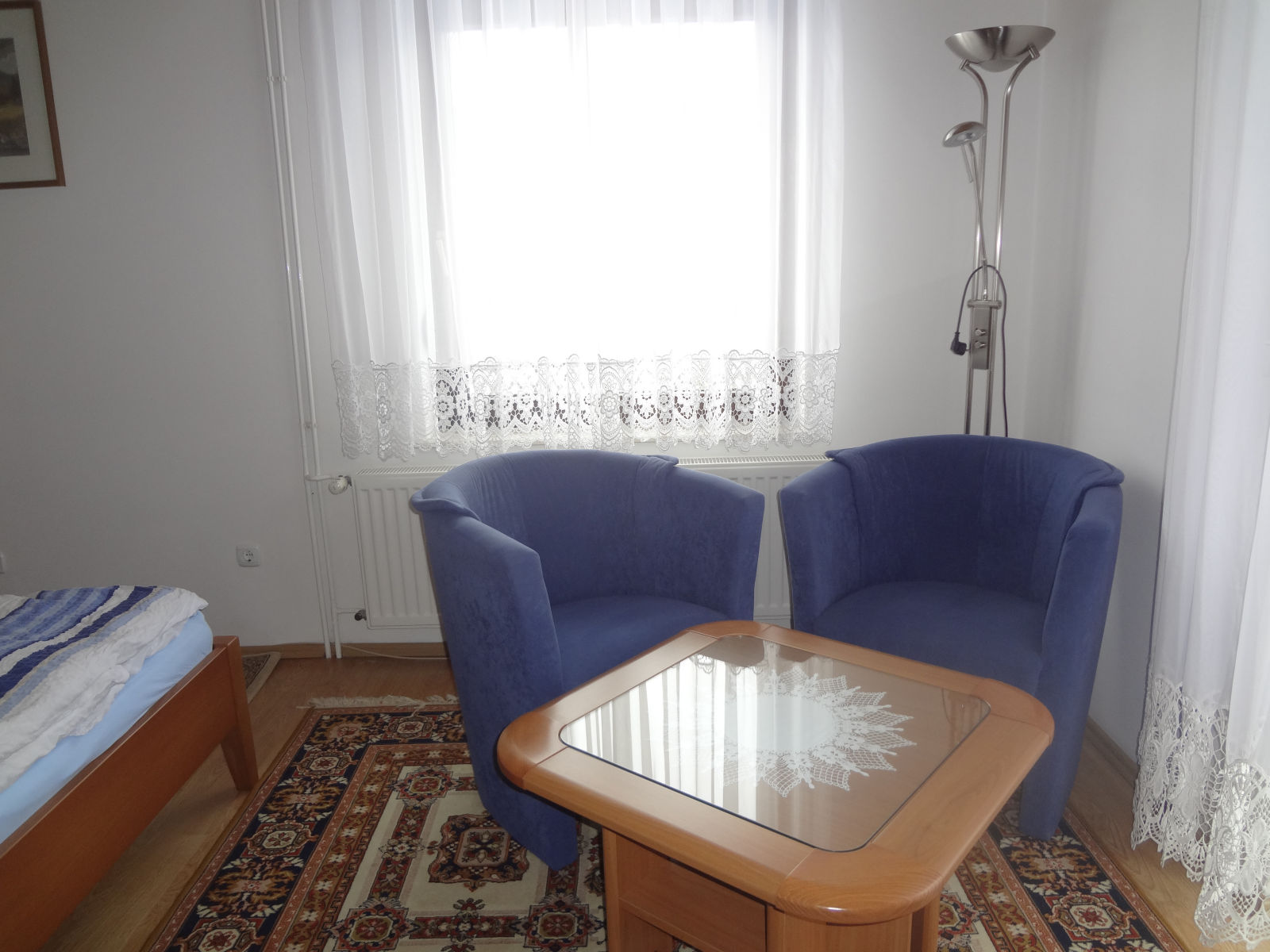 Two armchairs in the first bedroom of the Fine Stay Bled apartment in Lake Bled, Slovenia