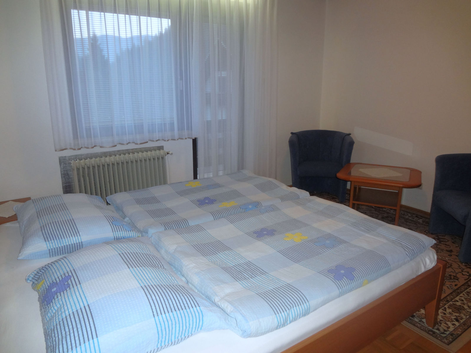 A king size bed in the second bedroom of the Fine Stay apartment in Lake Bled, Slovenia