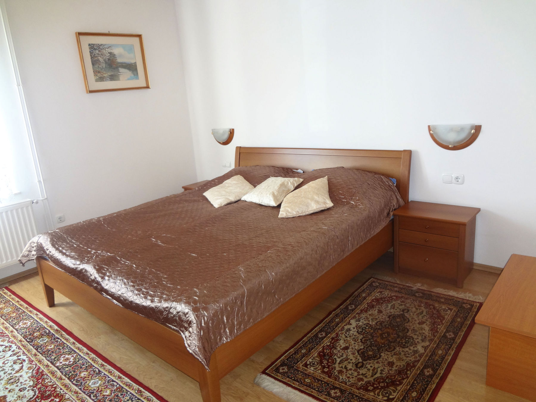 A king size bed in the second bedroom of the Fine Stay Bled apartment in Lake Bled, Slovenia