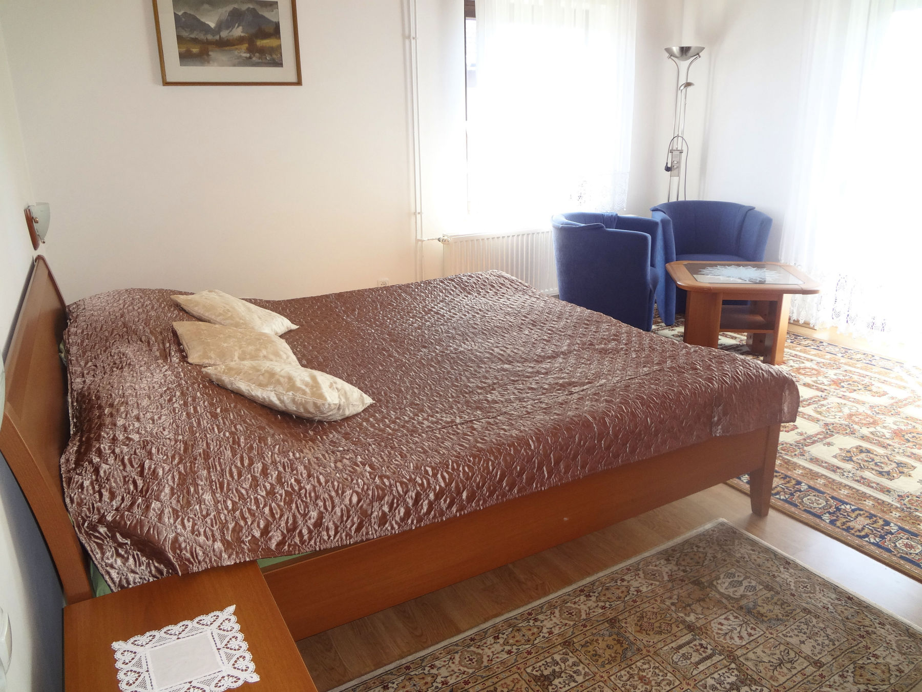 A king size bed in the first bedroom of the Fine Stay Bled apartment in Lake Bled, Slovenia