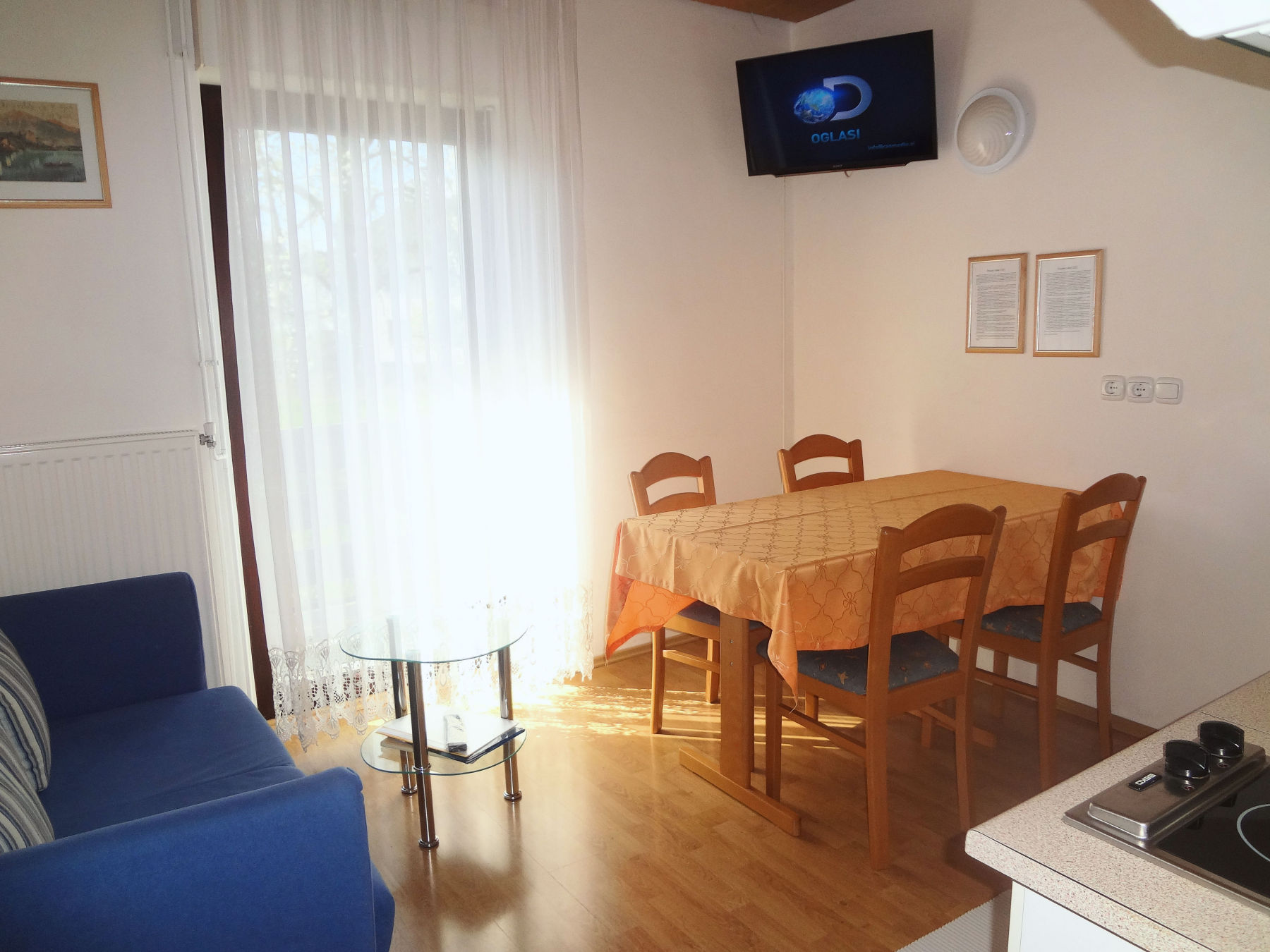 Dinning table and flat screen TV in the Fine Stay Apartments in Lake Bled, Slovenia