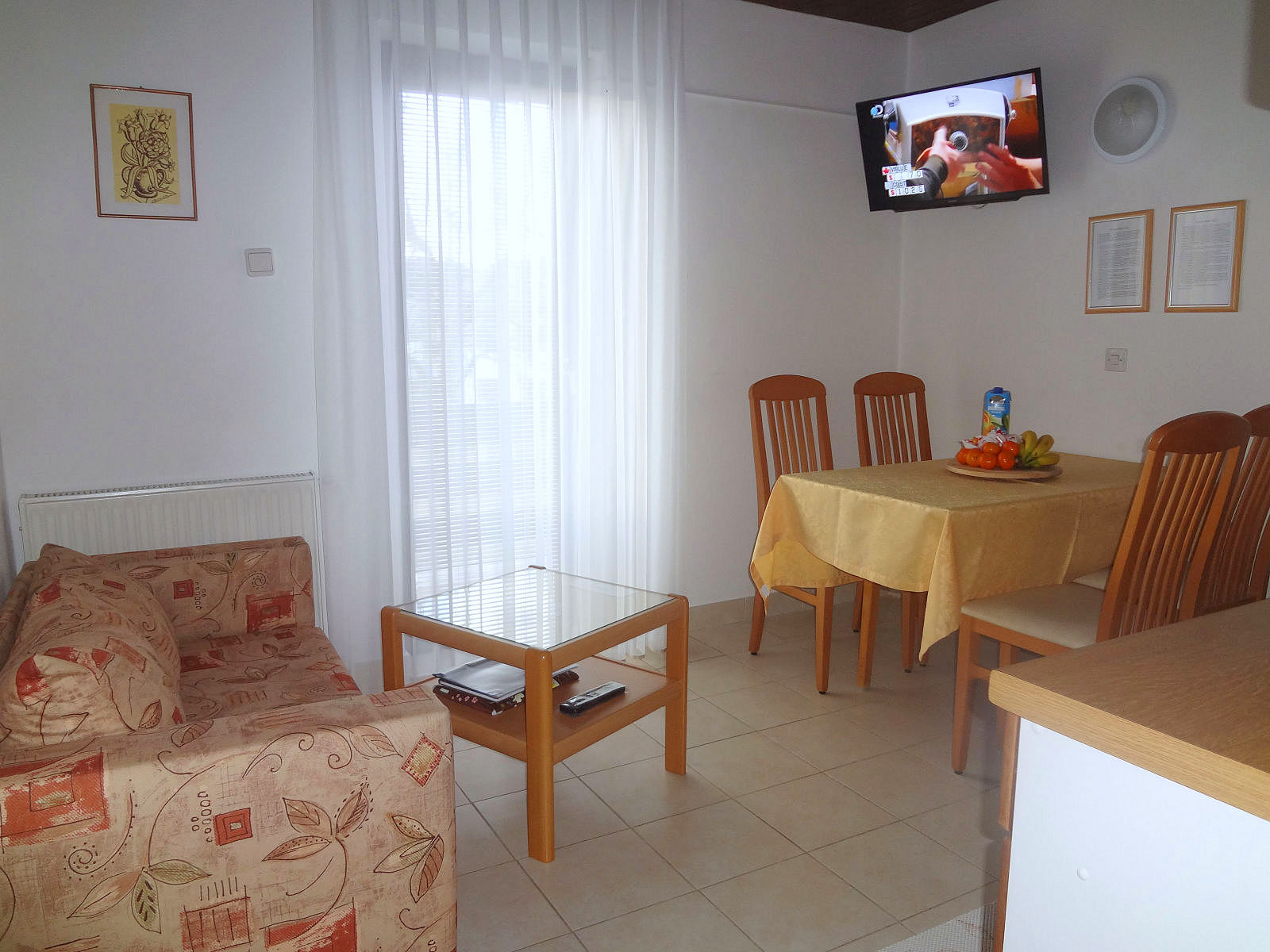 Kitchen and a dinning table and flat screen TV of the Fine Stay apartment in Lake Bled, Slovenia