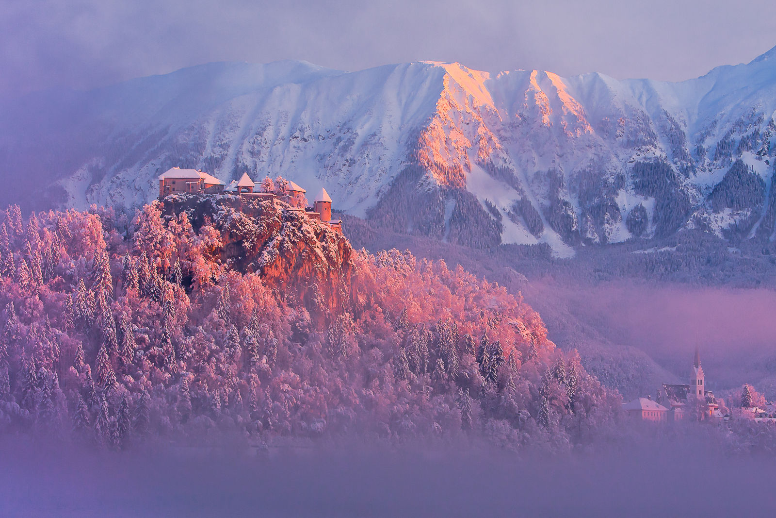 Bled Castle in winter with a covering of fresh snow