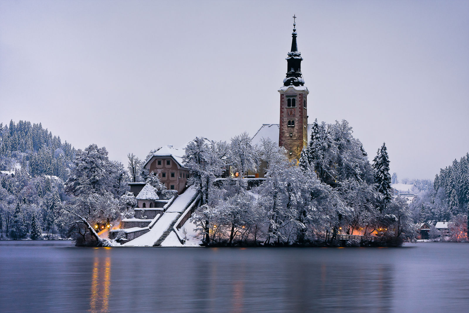 Bled Island on the winter evening with a covering of fresh snow