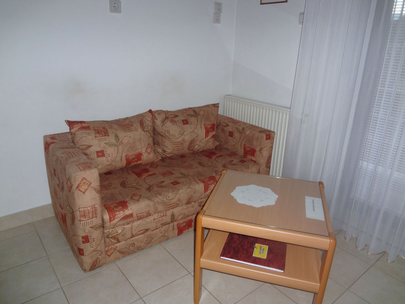 Two-seater sofa in the kitchen of the Fine Stay apartment in Lake Bled, Slovenia