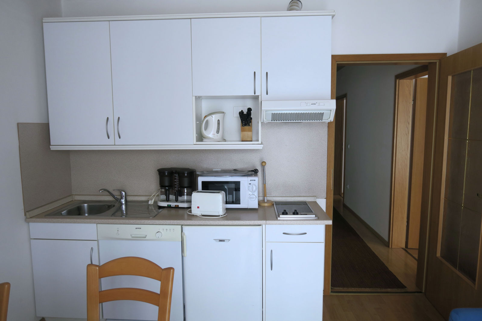 A white kitchen of the Fine Stay Bled apartment in Lake Bled, Slovenia