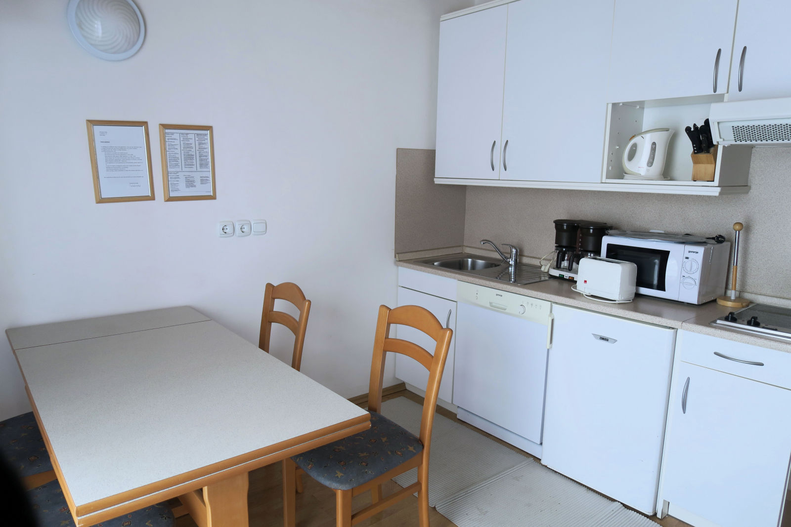 A fully fitted kitchen in the Fine Stay Bled apartment in Lake Bled, Slovenia
