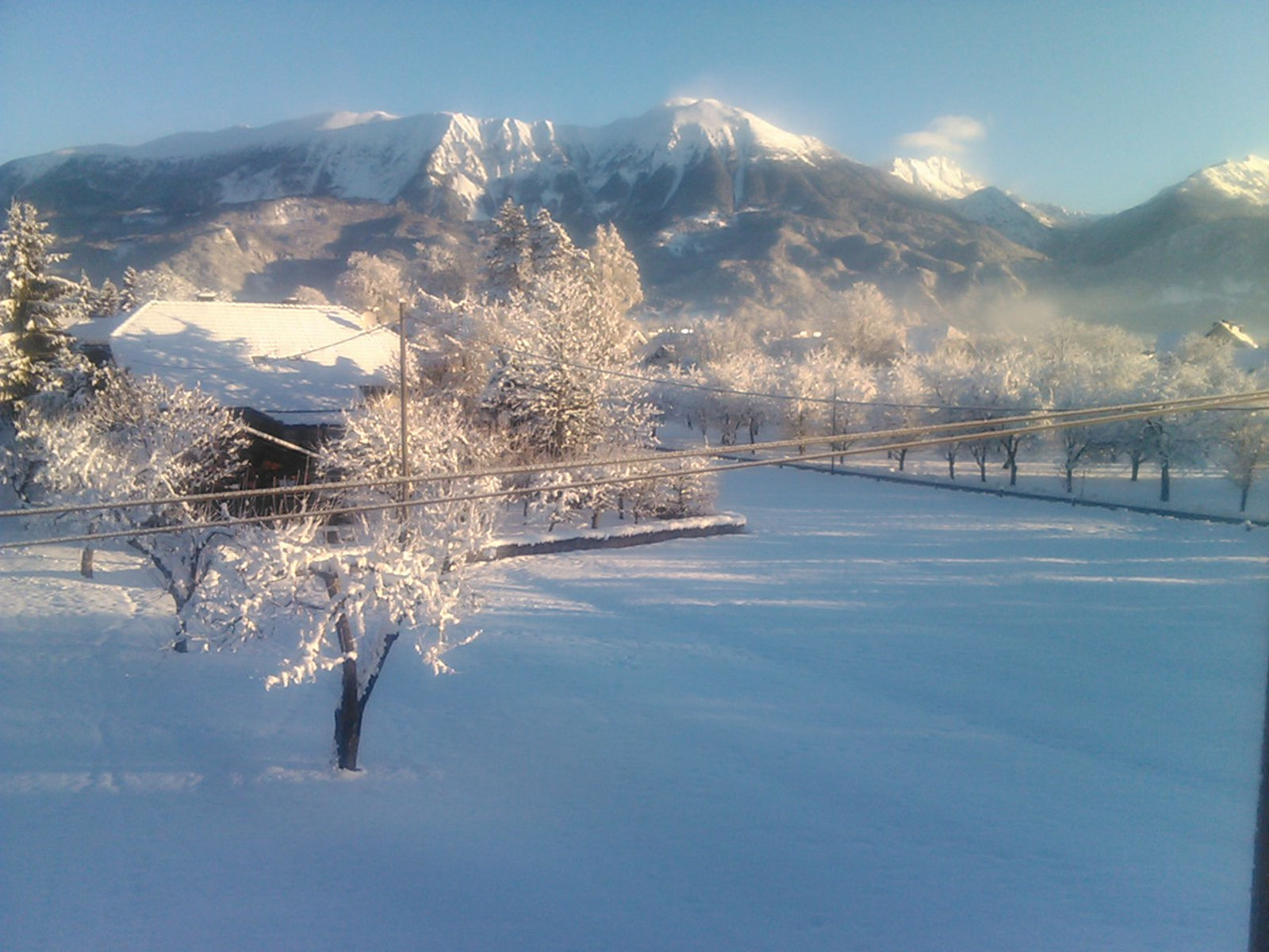 View of the mountains in winter from the Fine Stay apartment in Lake Bled, Slovenia