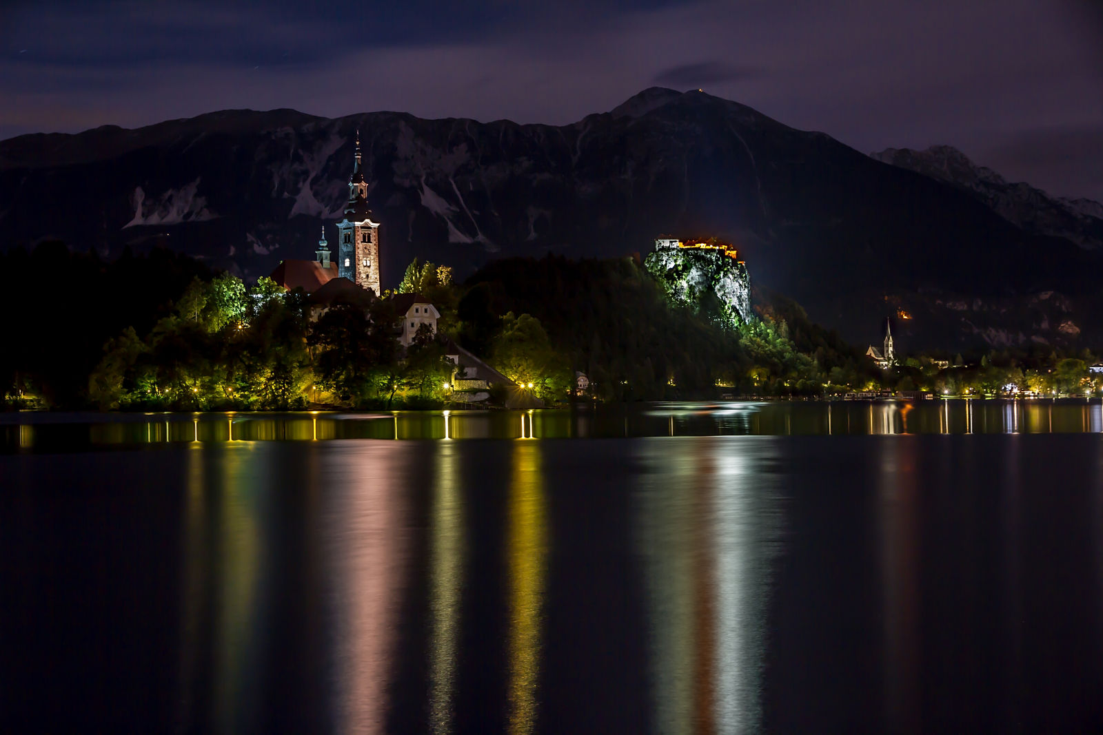 Lake Bled and its island and castle at night
