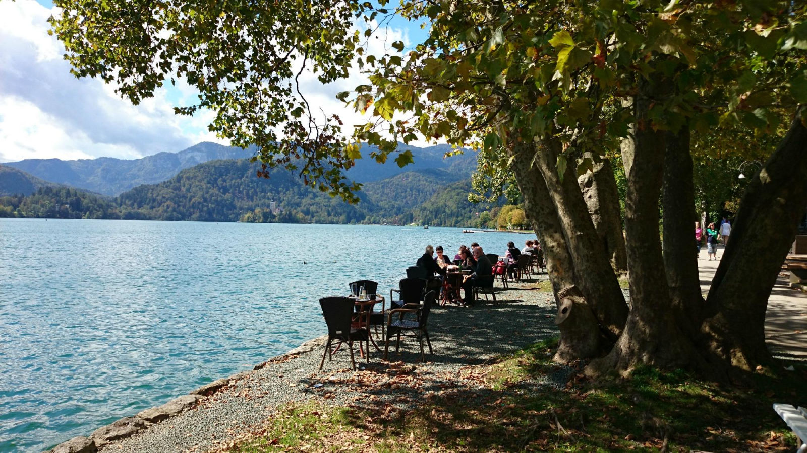 Outdoor lakeside tables of the Vila Preseren Restaurant and Cafe in Lake Bled, Slovenia