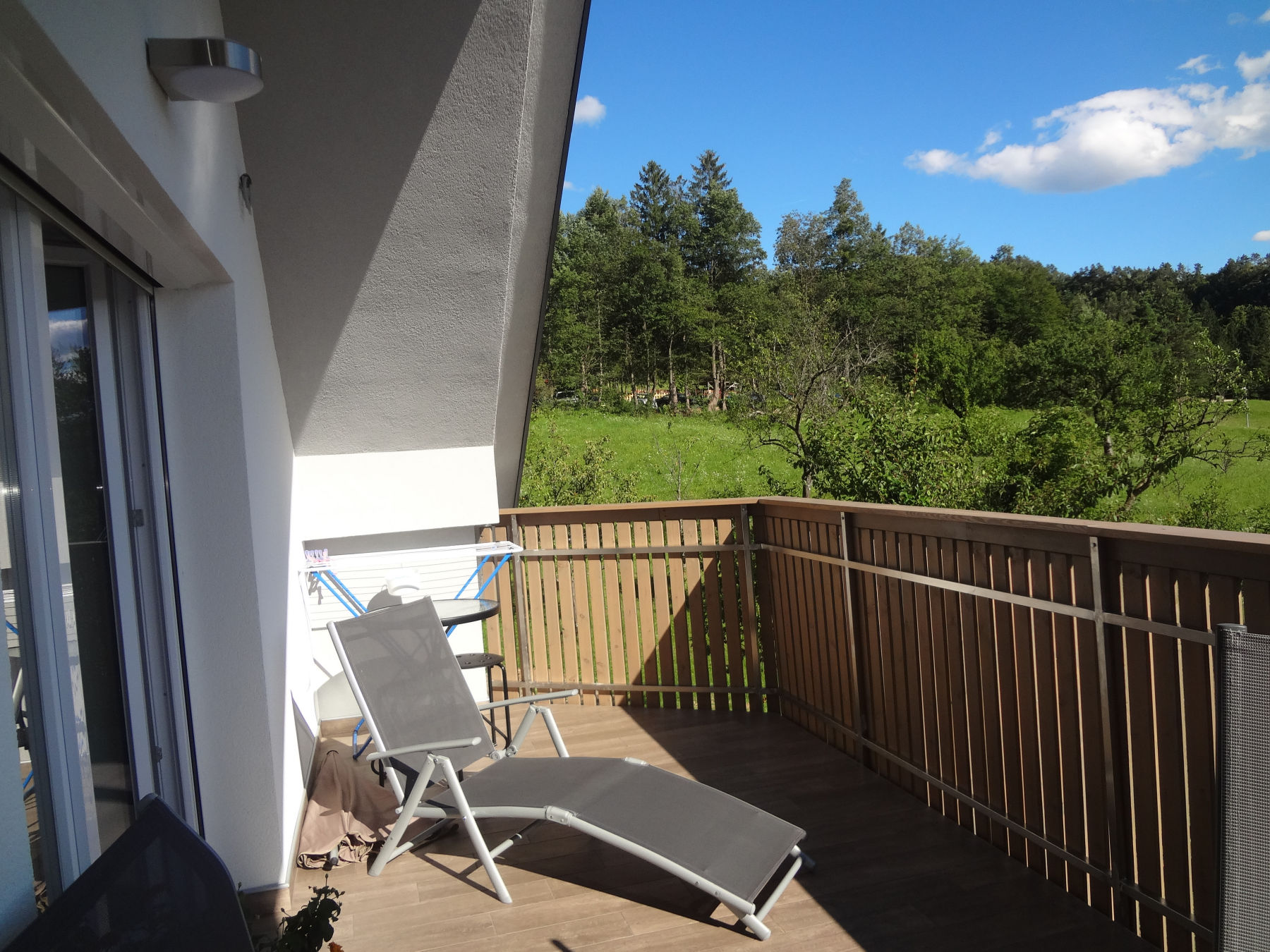 A sunbath chair on the balcony of the Fine Stay Apartment in the Bled Area Of Slovenia