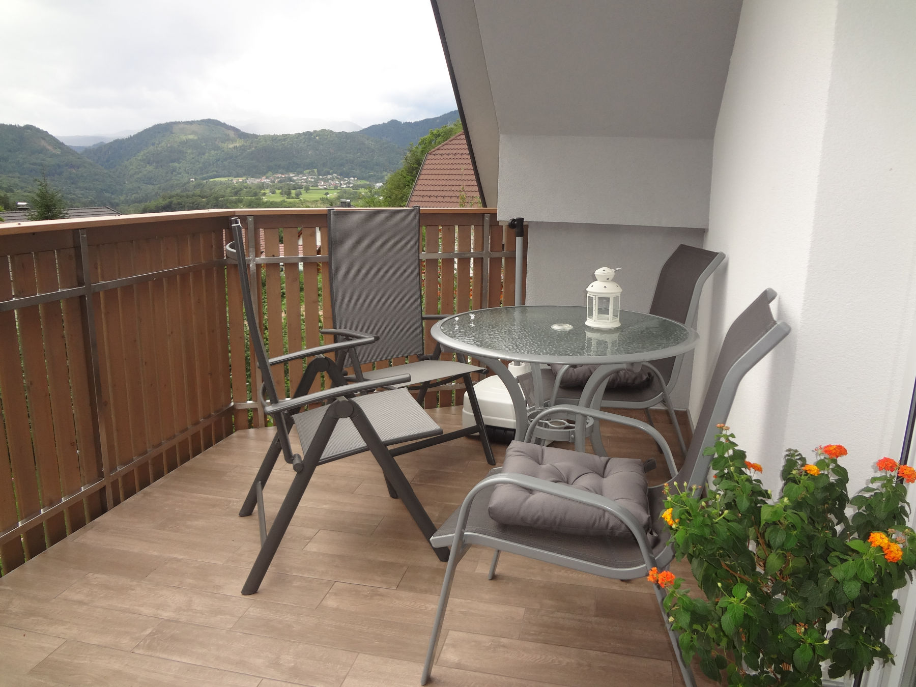 A balcony with garden furniture at the Fine Stay Apartment in the Bled Area Of Slovenia