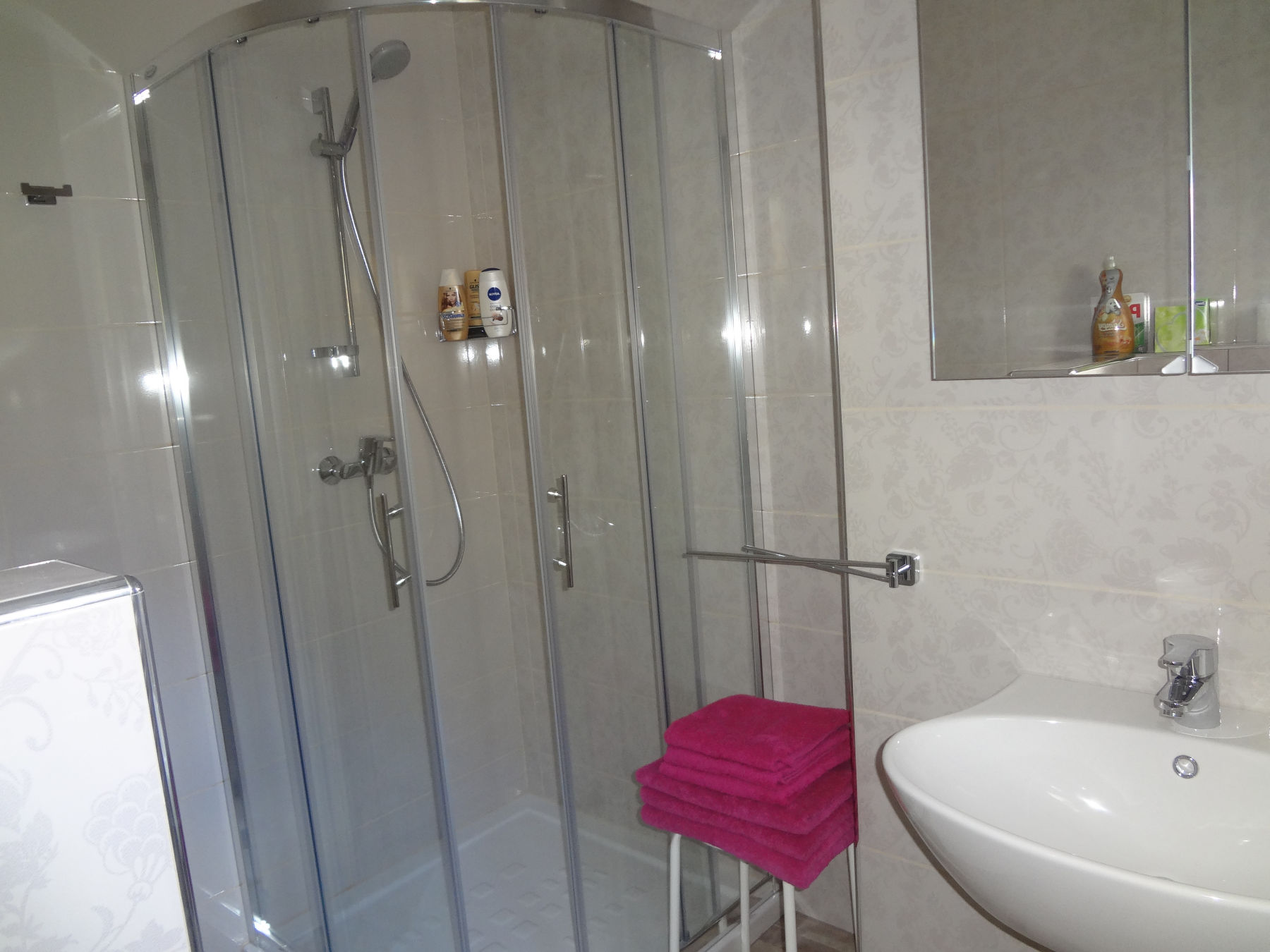A glass shower stall in the bathroom of the Fine Stay Apartment, the Bled area of Slovenia