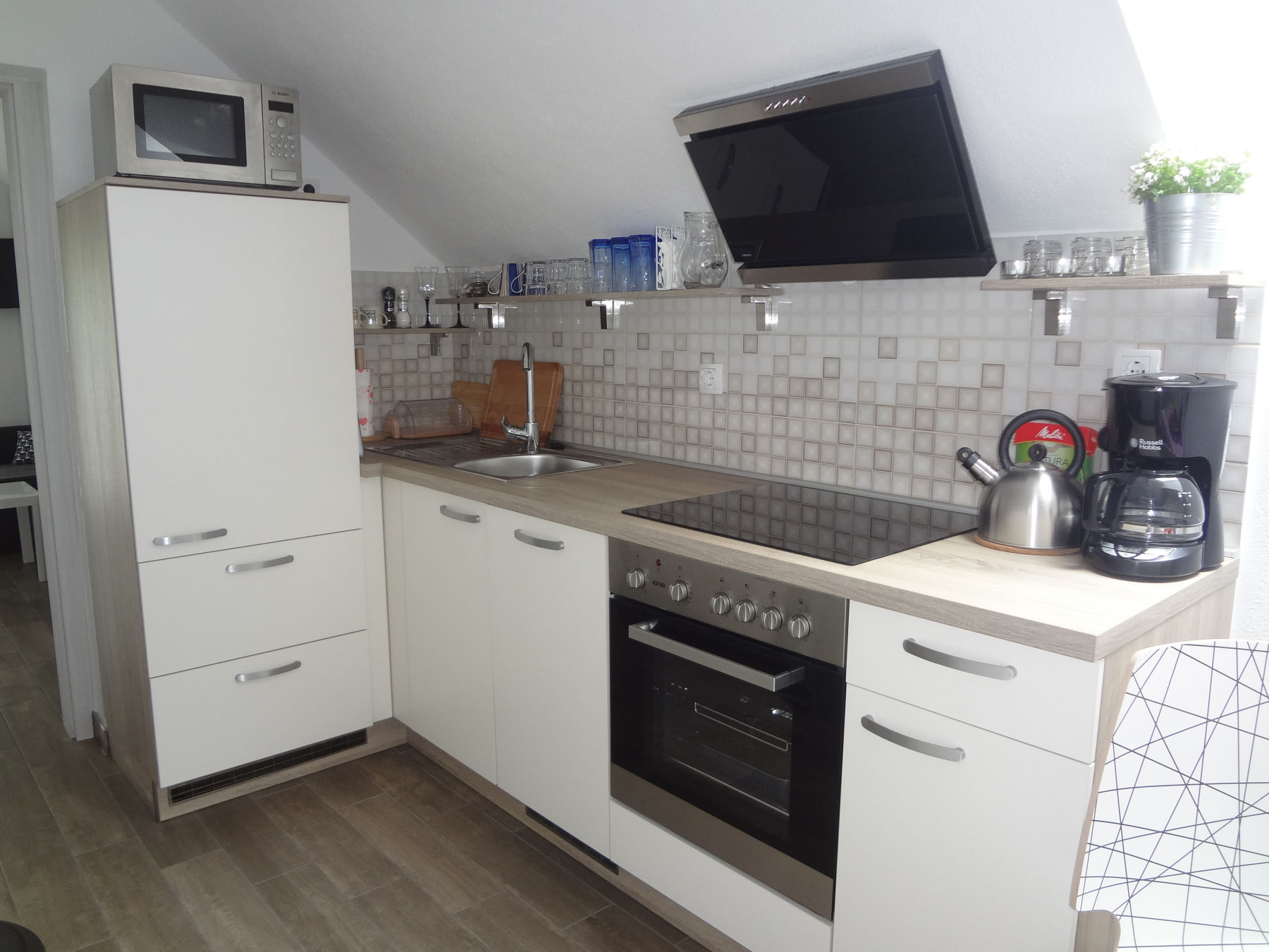 A well-equipped kitchen in the Fine Stay Apartment in the Bled Area Of Slovenia