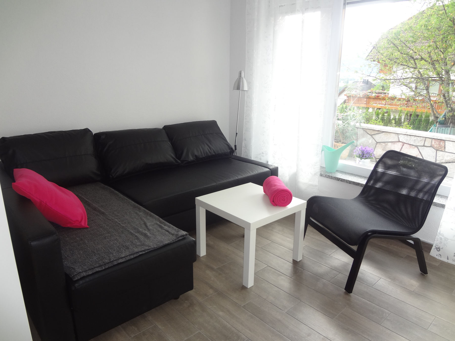 A sofa in the living area of the ground floor apartment located near Lake Bled, Slovenia