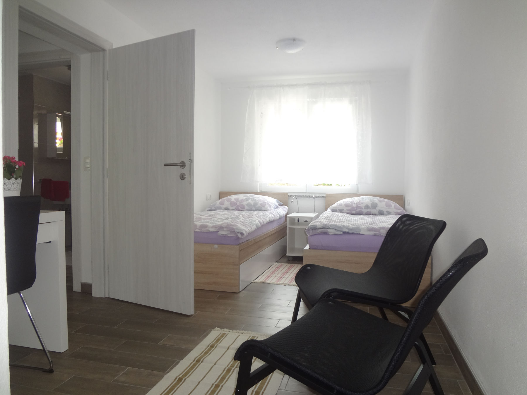 Second bedroom with two single beds in the Fine Stay Apartment, the Bled Area of Slovenia