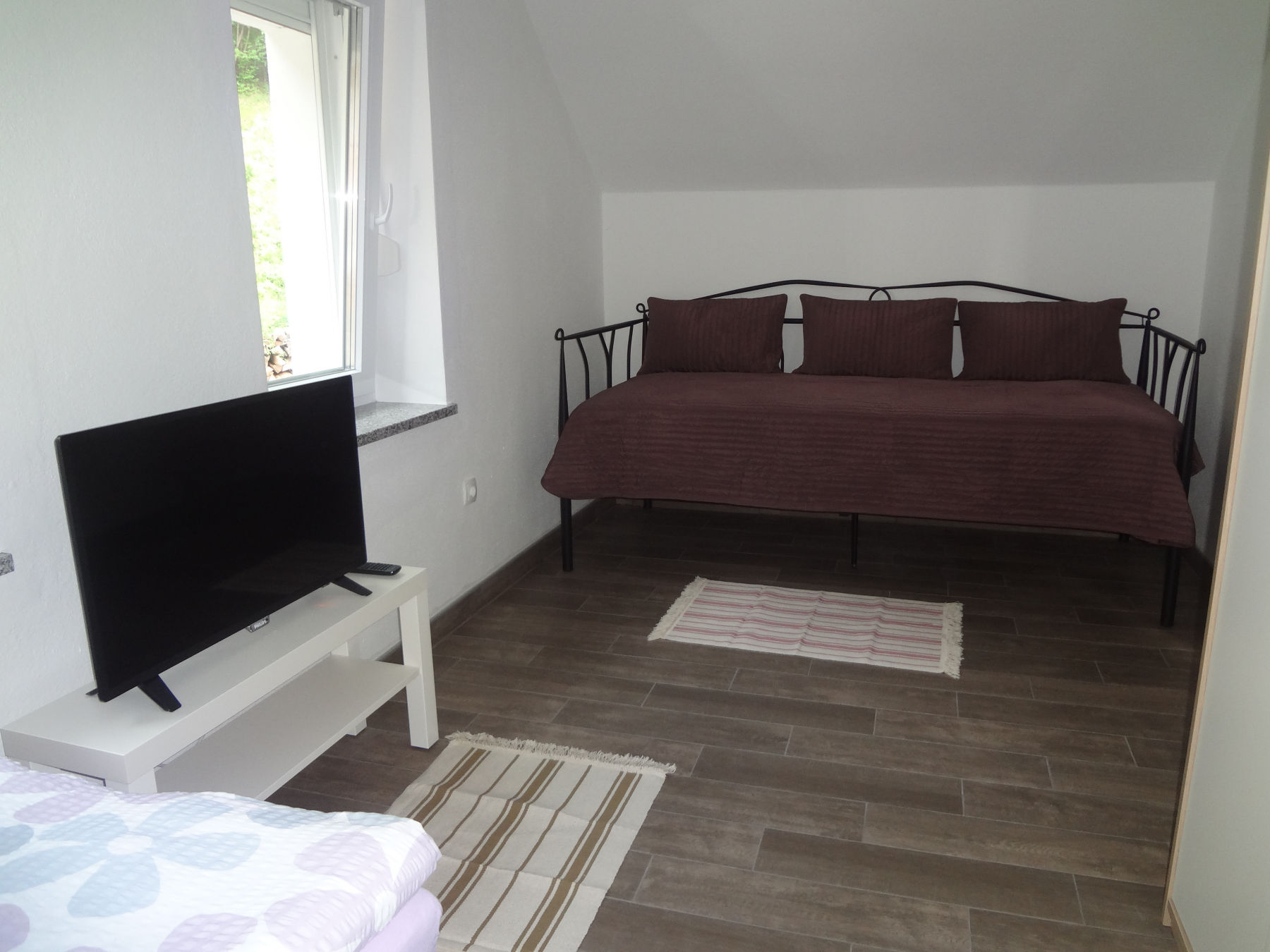 A sofa in the second bedroom of the Fine Stay Apartment in the Bled Area Of Slovenia