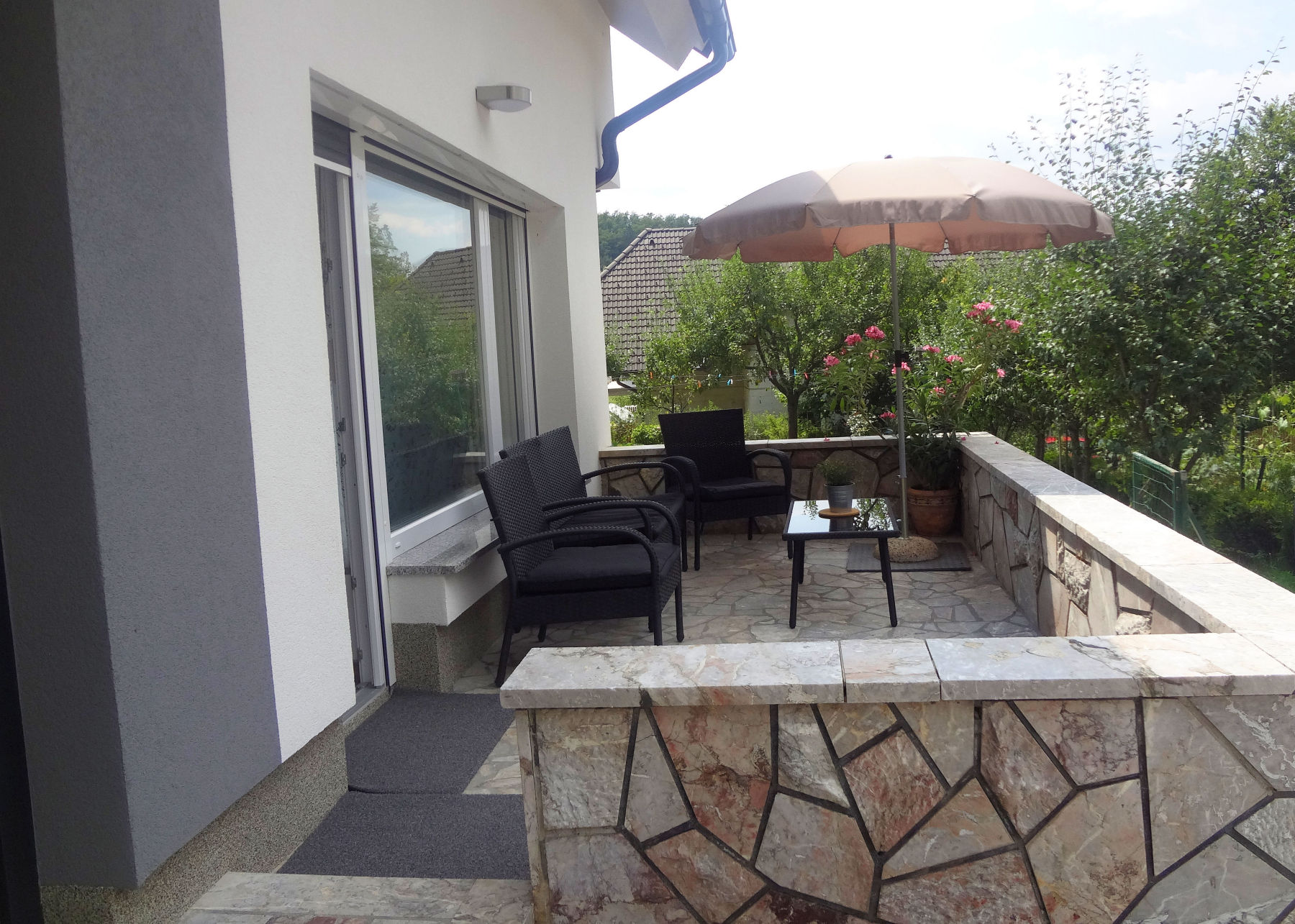 A terrace with garden furniture at Apartments Fine Stay in the Bled area of Slovenia