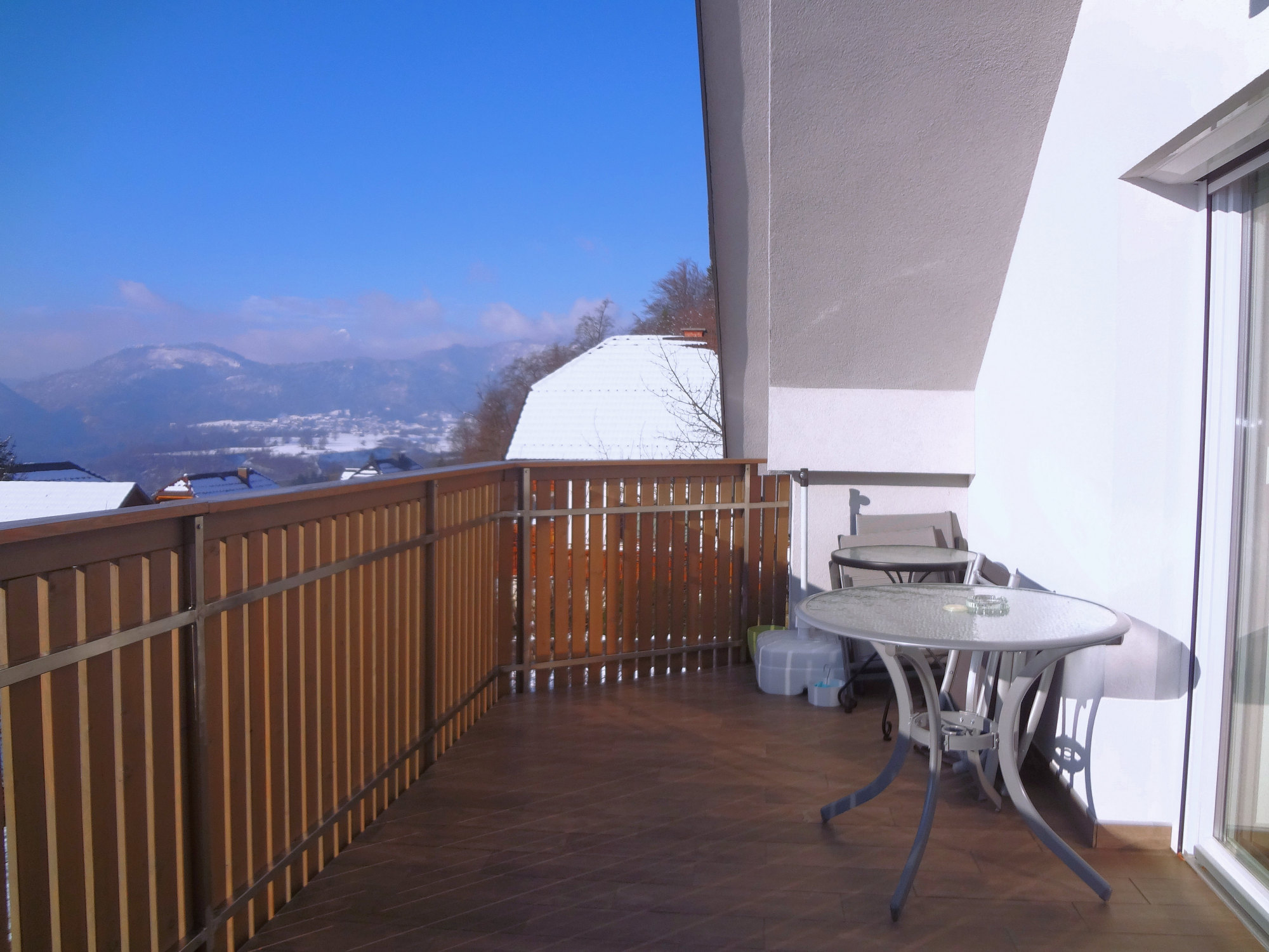A view of the Slovenian Alps from the balcony of Apartments Fine Stay Apartments in winter