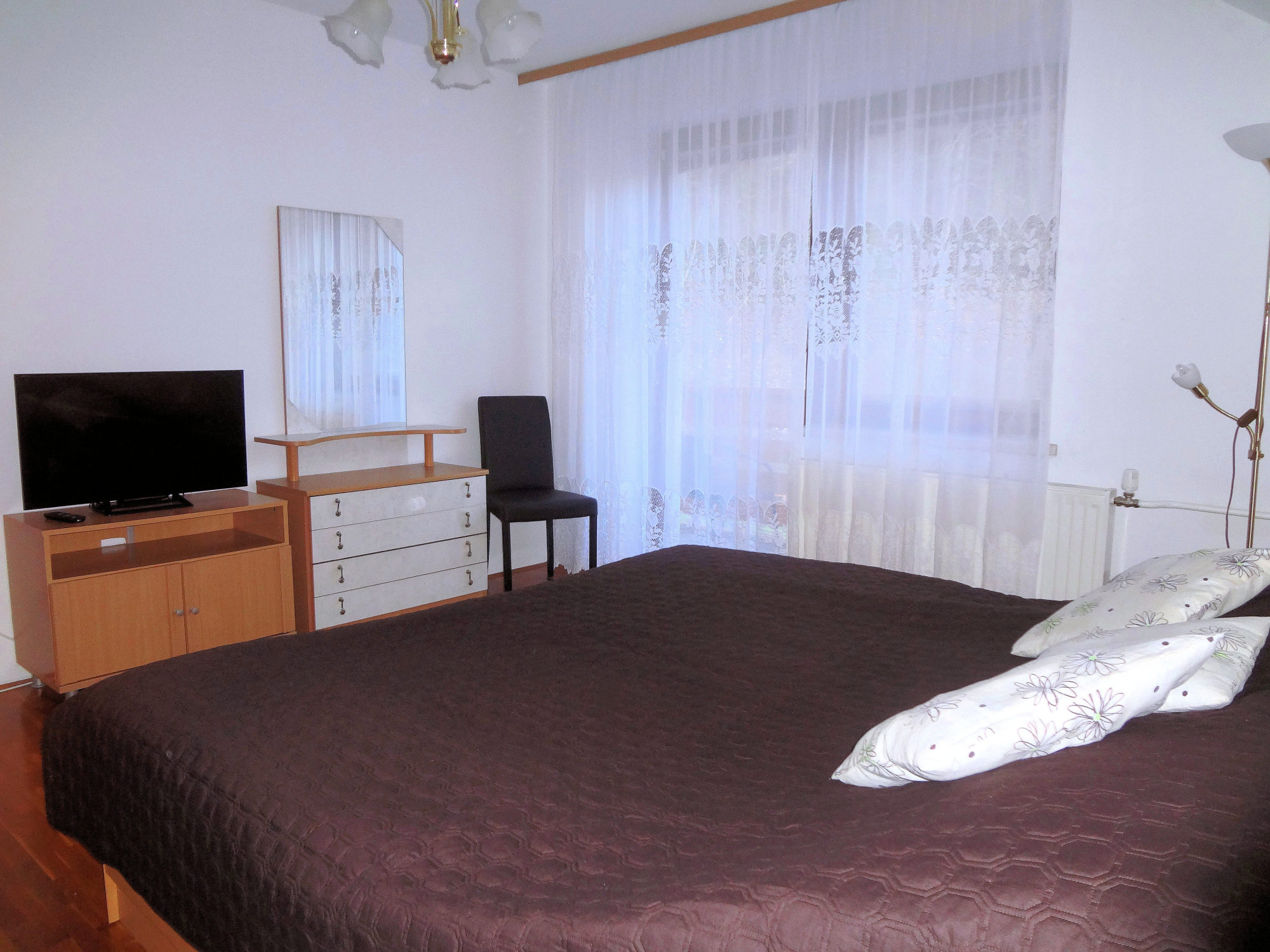 First bedroom of Apartments Fine Stay with a king size double bed and a flat screen TV