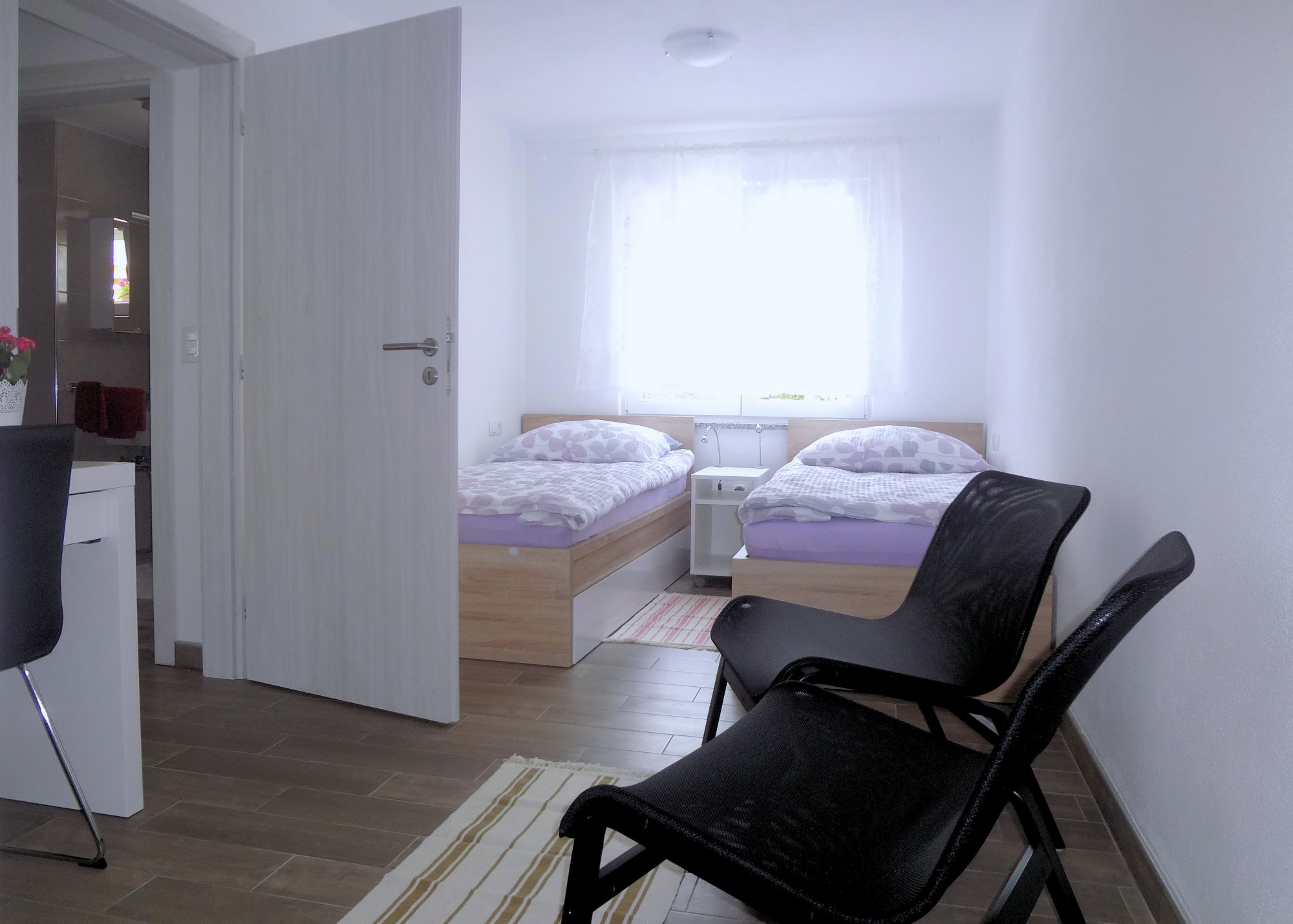 A bedroom with two single beds in Apartments Fine Stay in the Gorenjska region of Slovenia