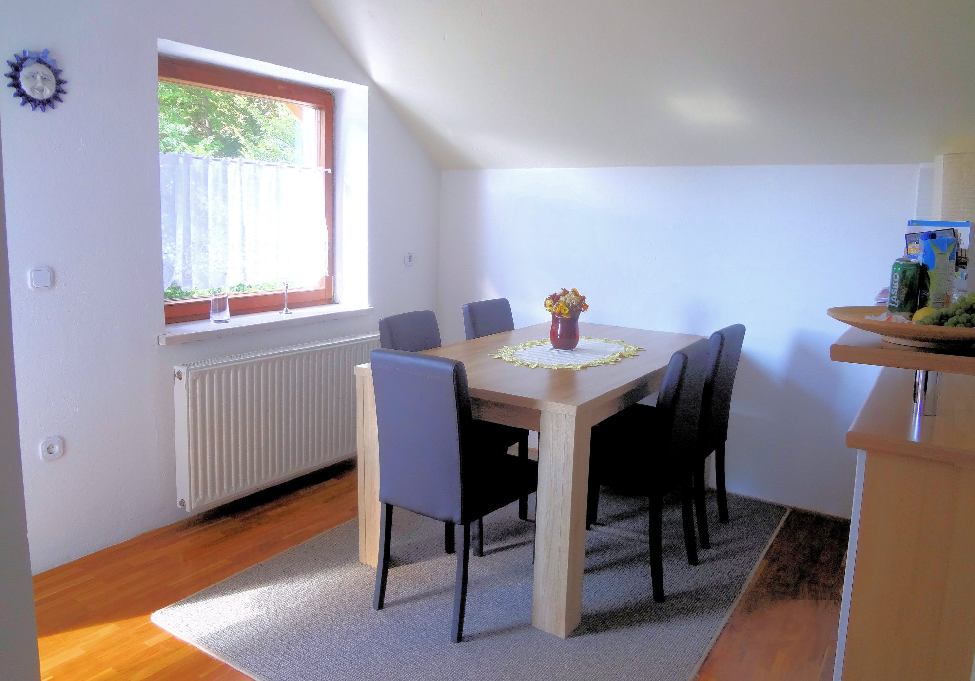 A dinning table in the dinning area of Apartments Fine Stay in the Bled area of Slovenia