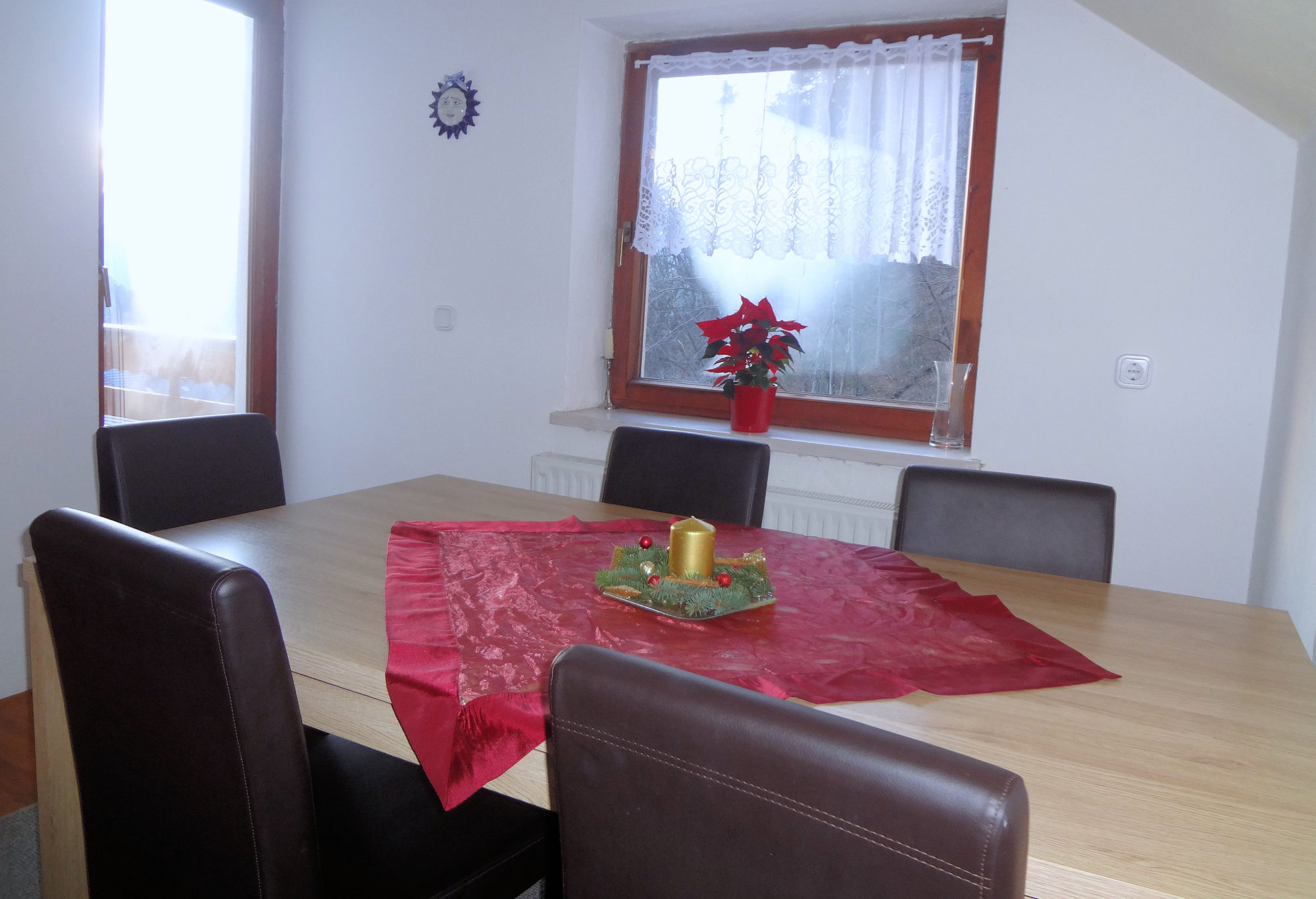 The dinning area of Apartments Fine Stay in the Bled area of Slovenia in the Christmas time