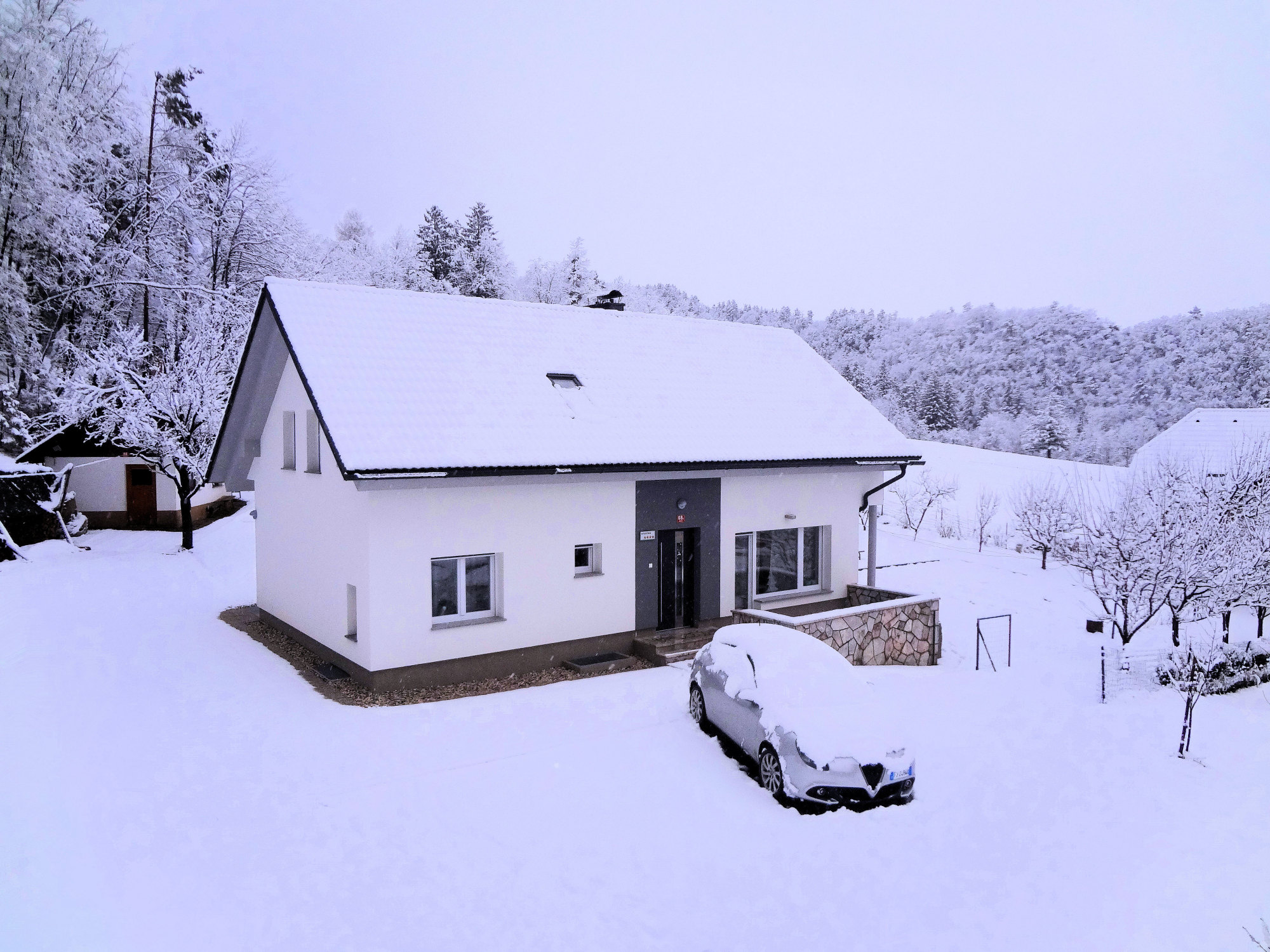 Elevated view of Apartments Fine Stay in the Gorenjska region of Slovenia in winter